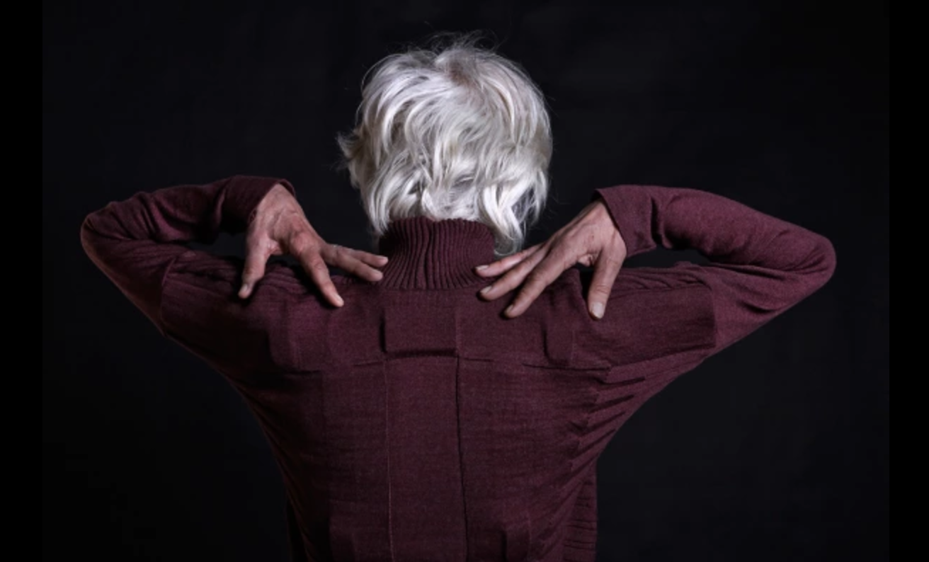 A Wool Cardigan That Doubles As A Physical Therapist