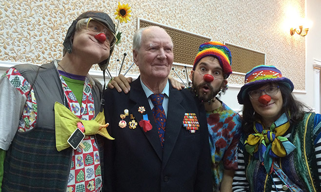 Photo Credit: Ralph Robbins    More than 40 garishly dressed volunteers all donned red noses and joined clown-doctor Patch Adams for two weeks of clowning at orphanages, homeless shelters, veterans' homes and hospitals in Moscow and St. Petersburg.