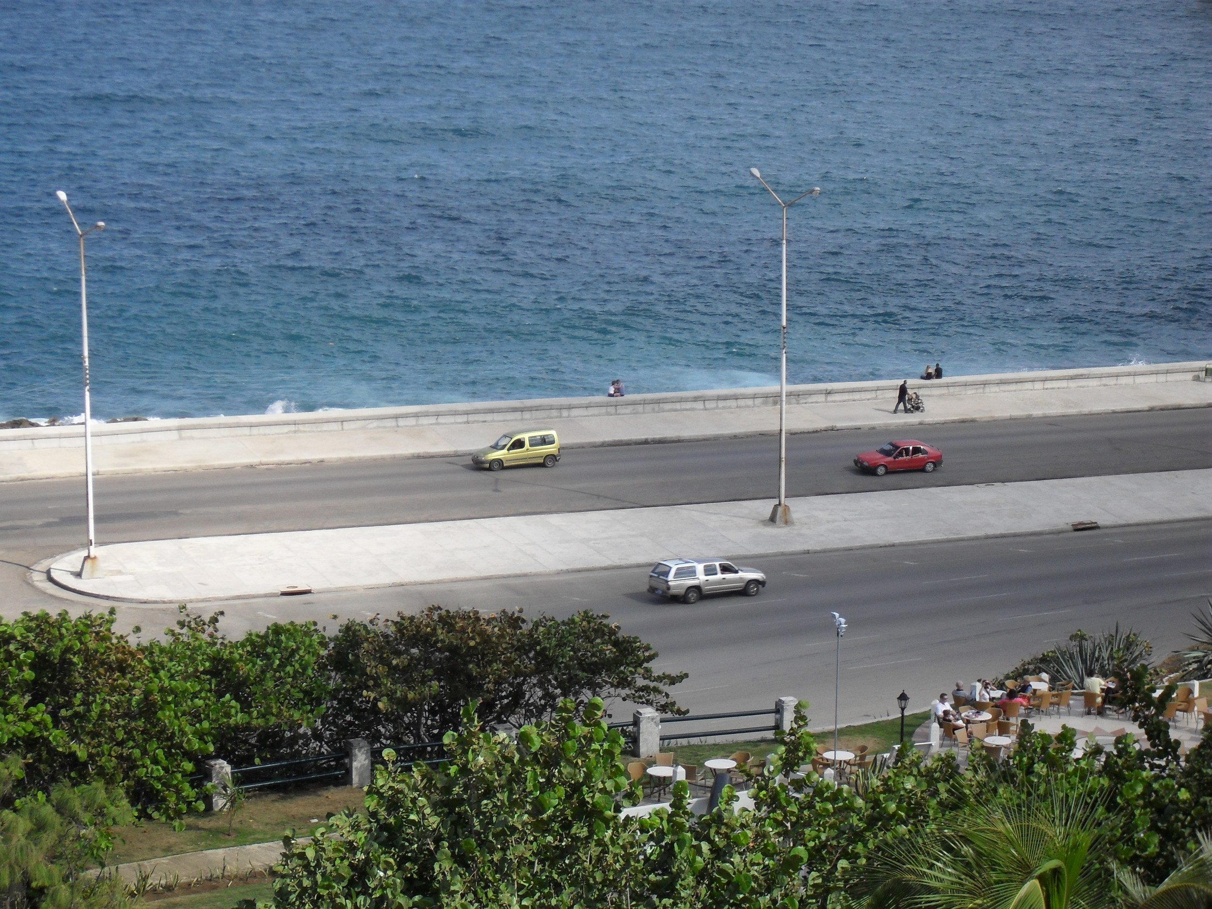 By day the Malecon is less crowded, as is the Nacional's garden bar (Foreground). Photo Credit Matt Lifflander