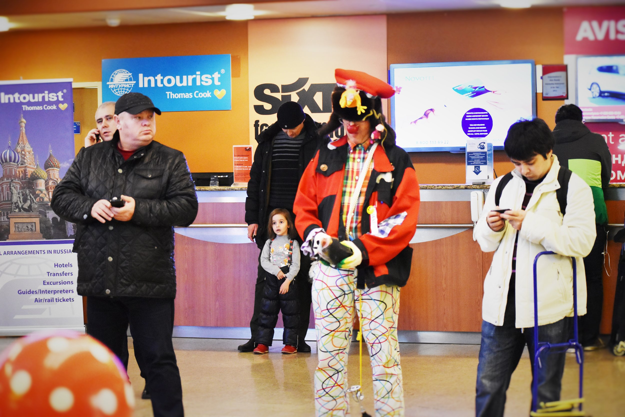 Clowns mixing with locals at Sheremetyevo