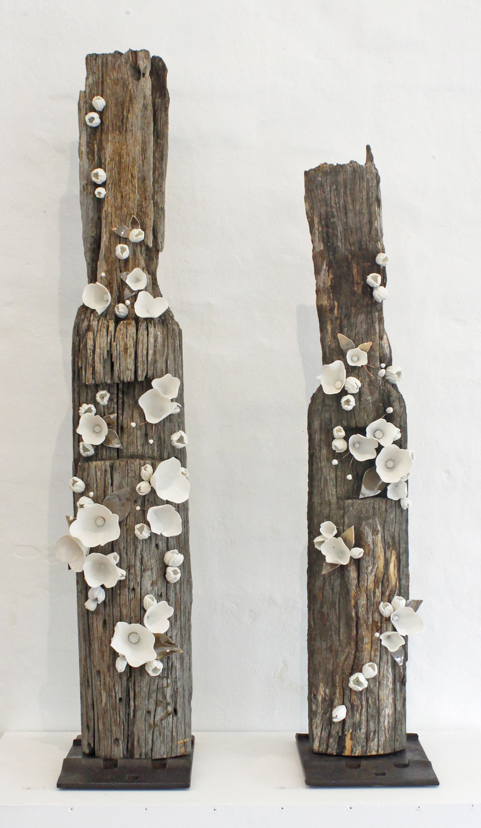 Amy Hick, Fence post no. 3 & 4, 2015.  Hand built imperial porcelain, weathered fence post, clear glaze, bronze glaze, copper wire, no.3 approximately 120x21x18cm, no.4 approximatelyb105x19x18  Photography: Madeline Young