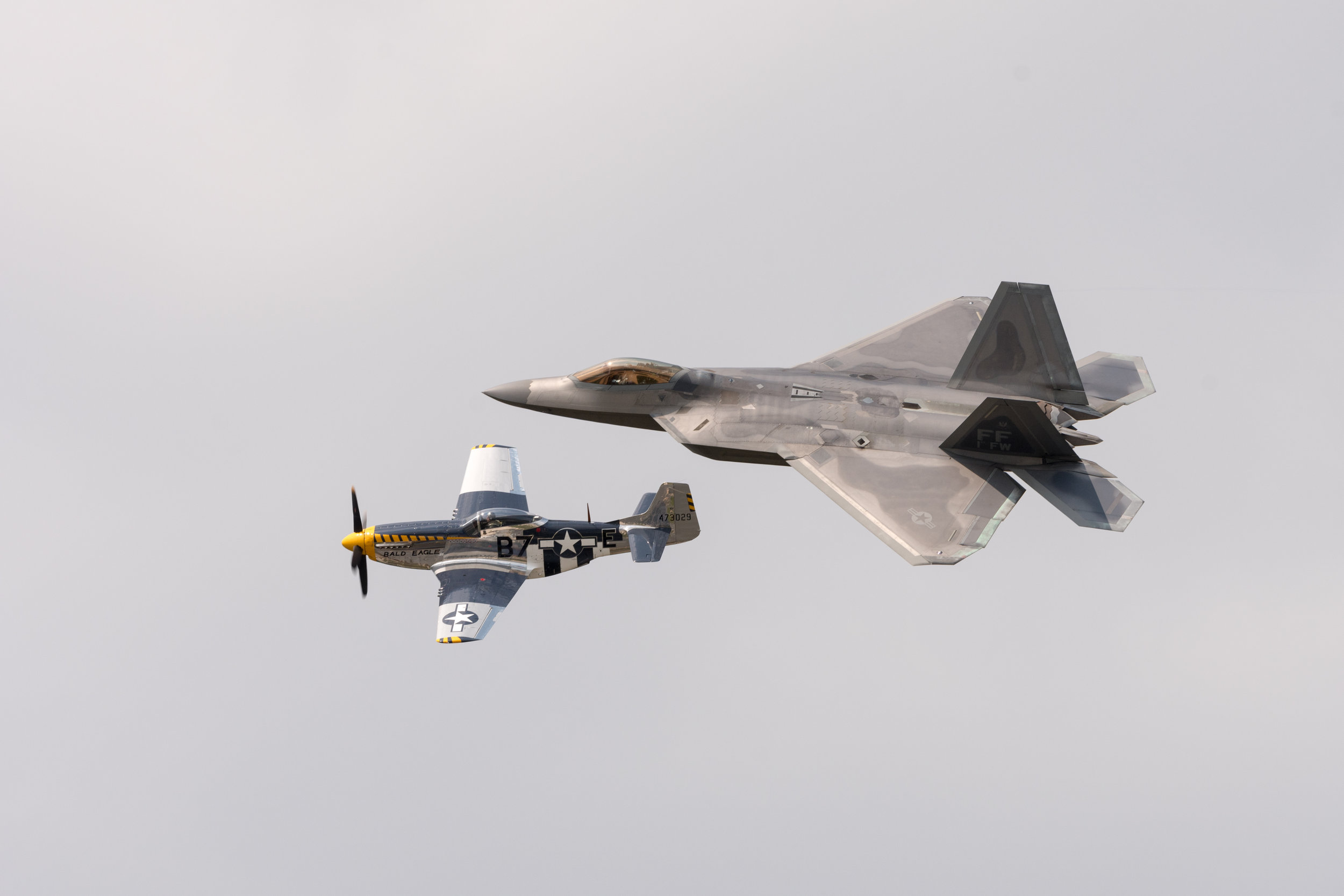 F-22 Raptor and P-51 Mustang Heritage flight at the Oceana Airshow
