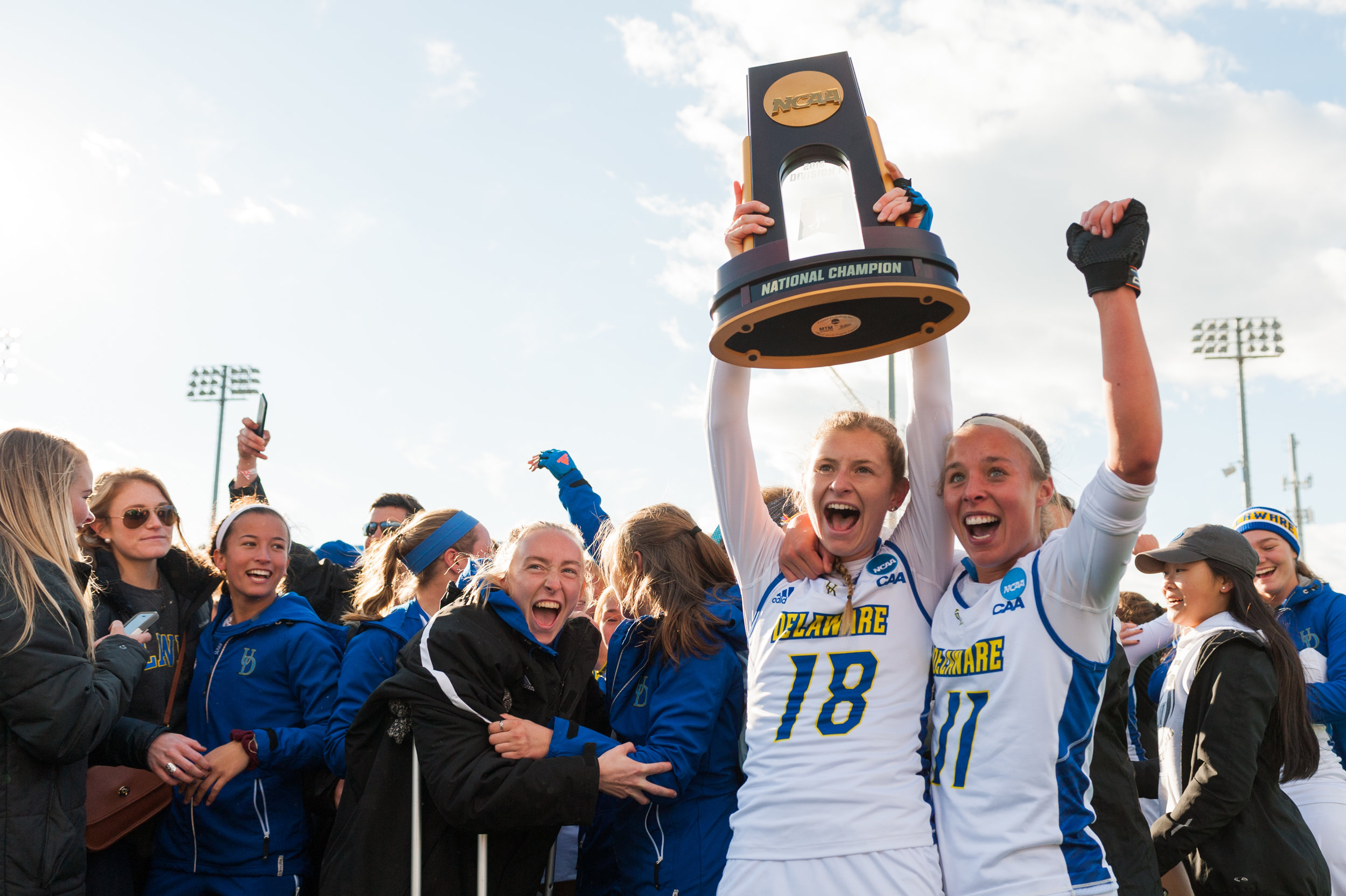 Delaware midfielder Maura Zarkoski (18) and midfielder Mackenzie Mick (11) celebrate after defeating the North Carolina Tar Heels during the 2016 NCAA DI National Championship at the L.R. Hill Sports Complex in Norfolk, VA. Delaware defeated North Carolina 3-2.