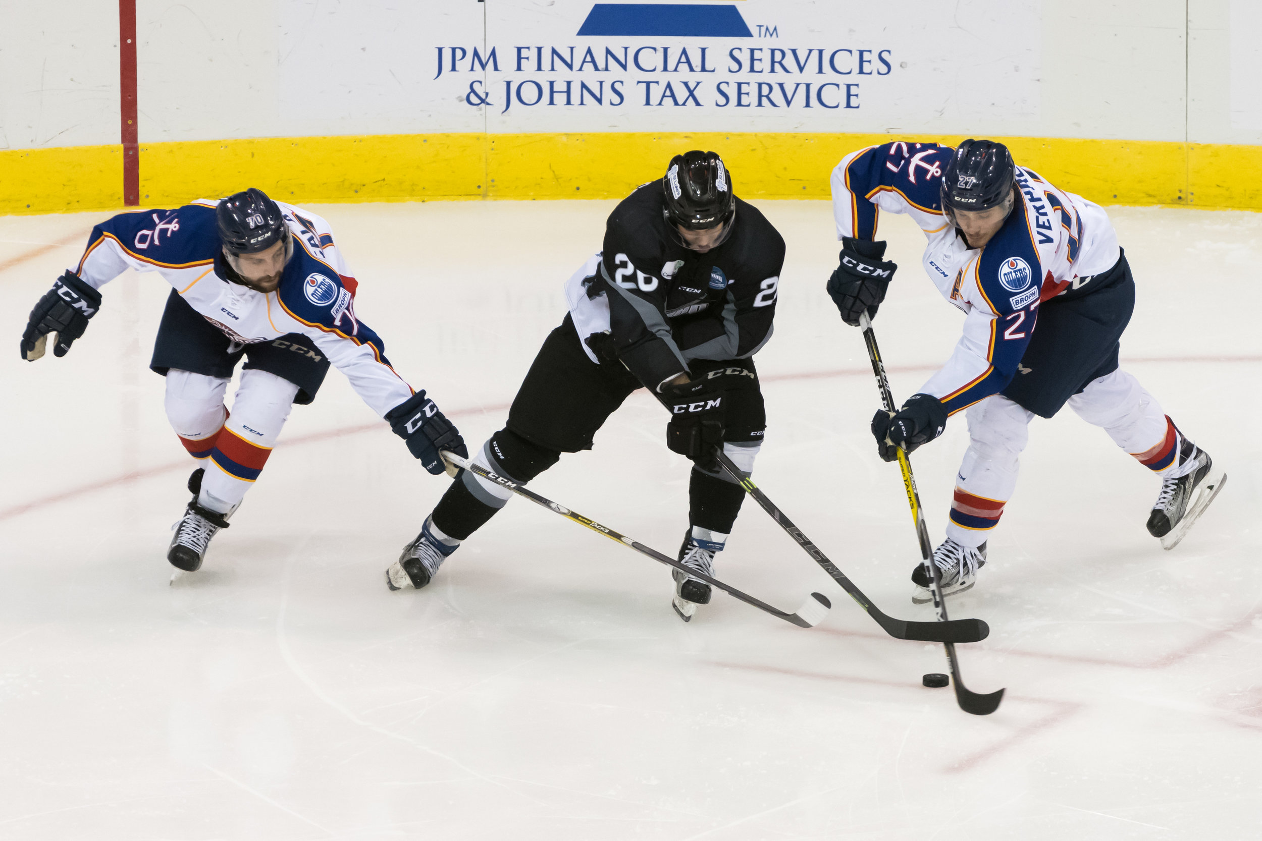 Idaho Steelheads forward Rob Linsmayer (26), Norfolk Admirals defenseman Anthony Calabrese (70) and defenseman Gabriel Verpaelst (27) fight for the puck during Wednesday night's game at the Scope Arena in Norfolk, Virginia. Idaho defeated Norfolk 6-4.