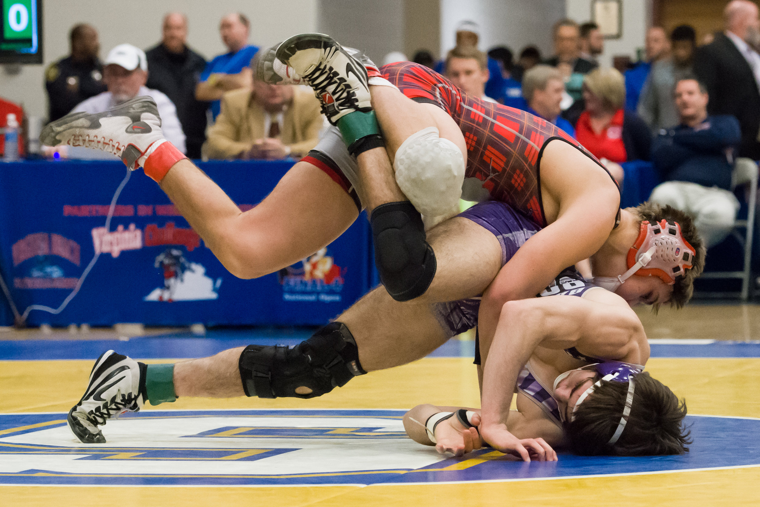 Battlefield High School's Ronald Miller (purple singlet) wrestles McLean High School's Brendan Grammes during the 152 pound VHSL 6A State Championship held at Oscar Smith High School on February 18th, 2017. Miller came in second place in the VHSL 6A State Championship.