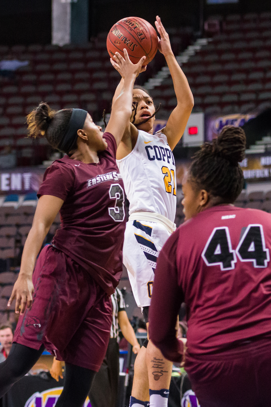 Coppin State Lady Eagles guard Keena Samuels (21) goes up for a shot against Maryland Eastern Shore Lady Hawks guard Alexus Hicks (3) during the 2017 MEAC Tournament held at the Scope Arena in Norfolk, VA. Maryland Eastern Shore defeated Coppin State 62-59.