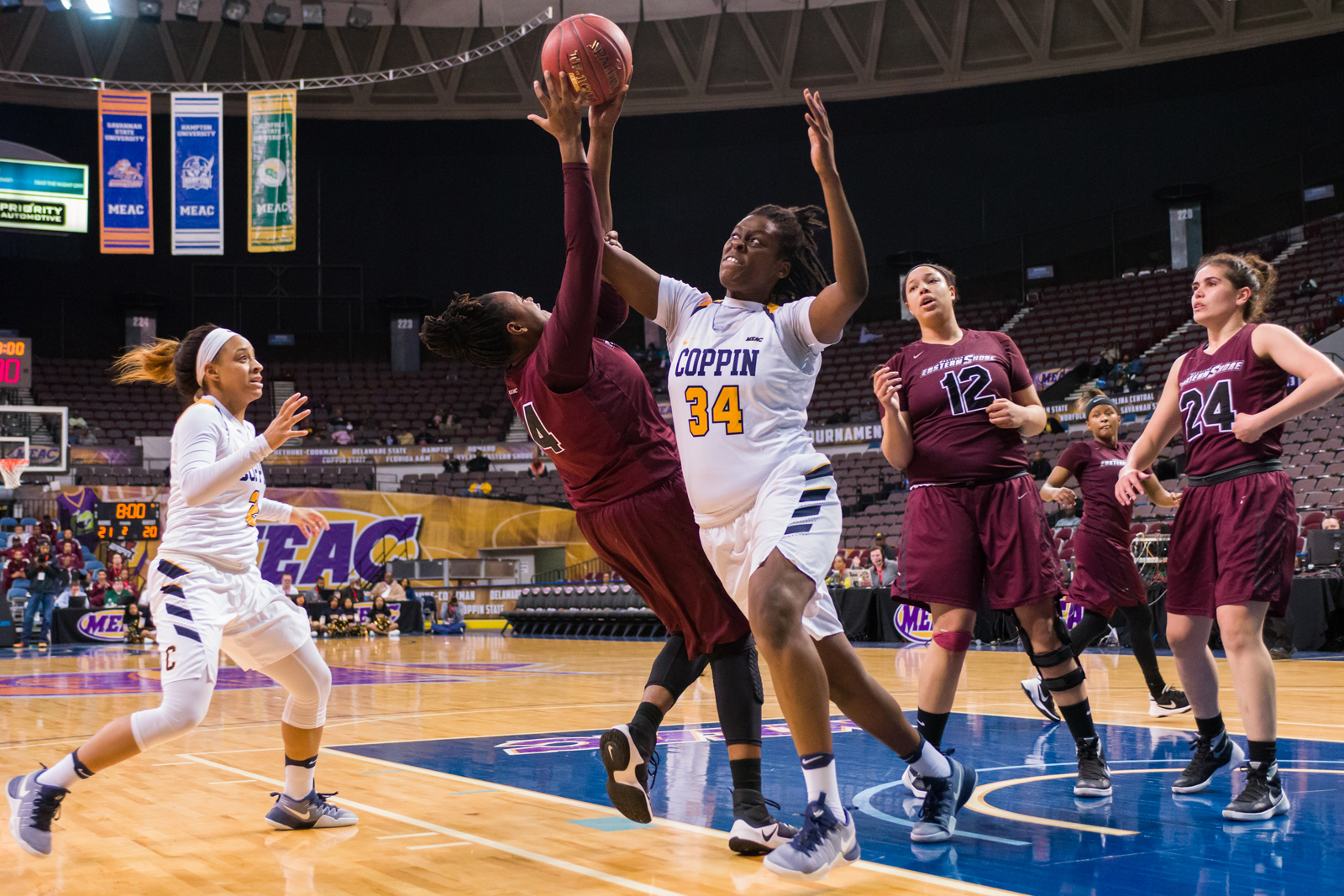 Maryland Eastern Shore Lady Hawks forward Shauntesha Bryant (44) takes a shot against Coppin State Lady Eagles center Oluwaseun Adeniji (34) during the 2017 MEAC Tournament held at the Scope Arena in Norfolk, VA. Maryland Eastern Shore defeated Coppin State 62-59.
