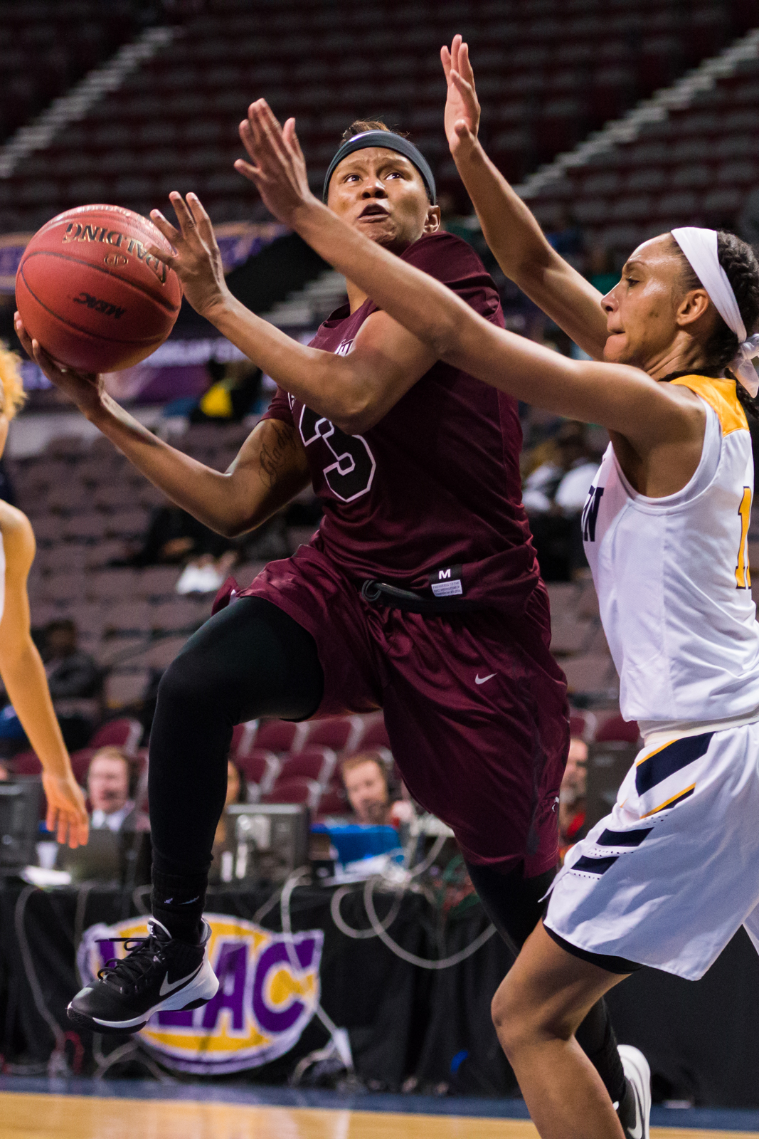 Maryland Eastern Shore Lady Hawks guard Alexus Hicks (3) goes up for a shot against Coppin State Lady Eagles forward Candice Beverly (11) during the 2017 MEAC Tournament held at the Scope Arena in Norfolk, VA. Maryland Eastern Shore defeated Coppin State 62-59.