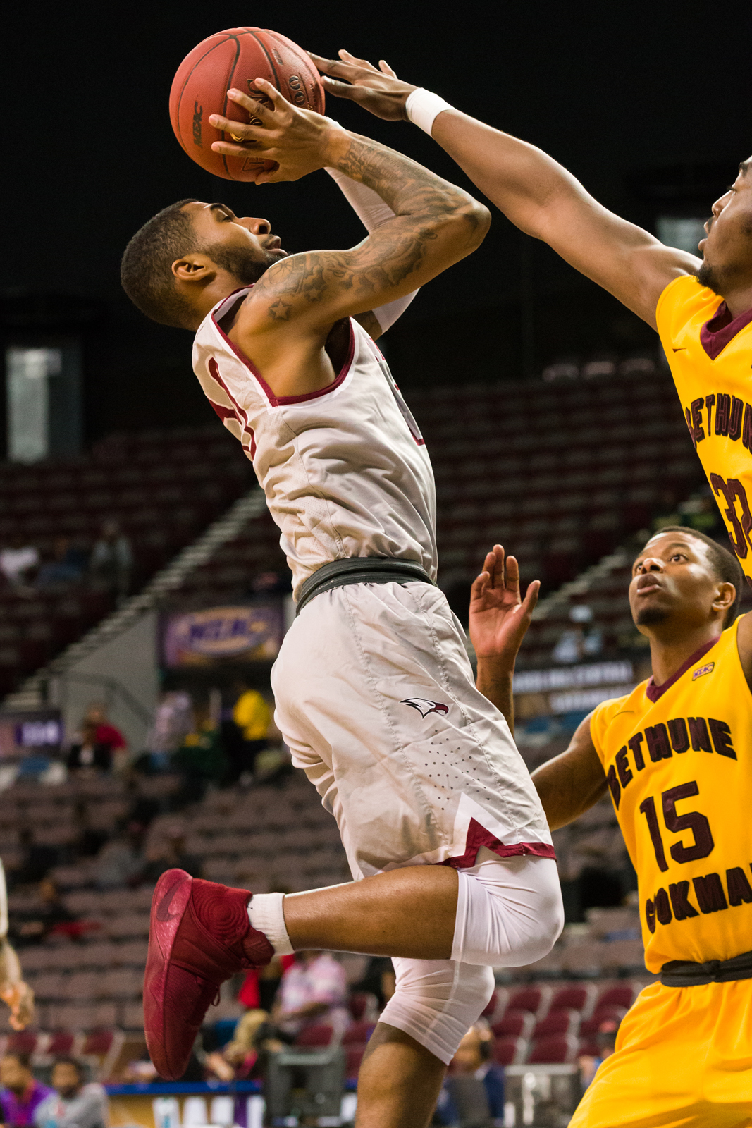 North Carolina Central Eagles guard Dajuan Graf (10) goes up for a shot against Bethune-Cookman Wildcats forward Ulmer Manzie (32) and guard Reggie Baker (15) during the 2017 MEAC Tournament held at the Scope Arena in Norfolk, VA. North Carolina Central defeated Bethune-Cookman 95-60.