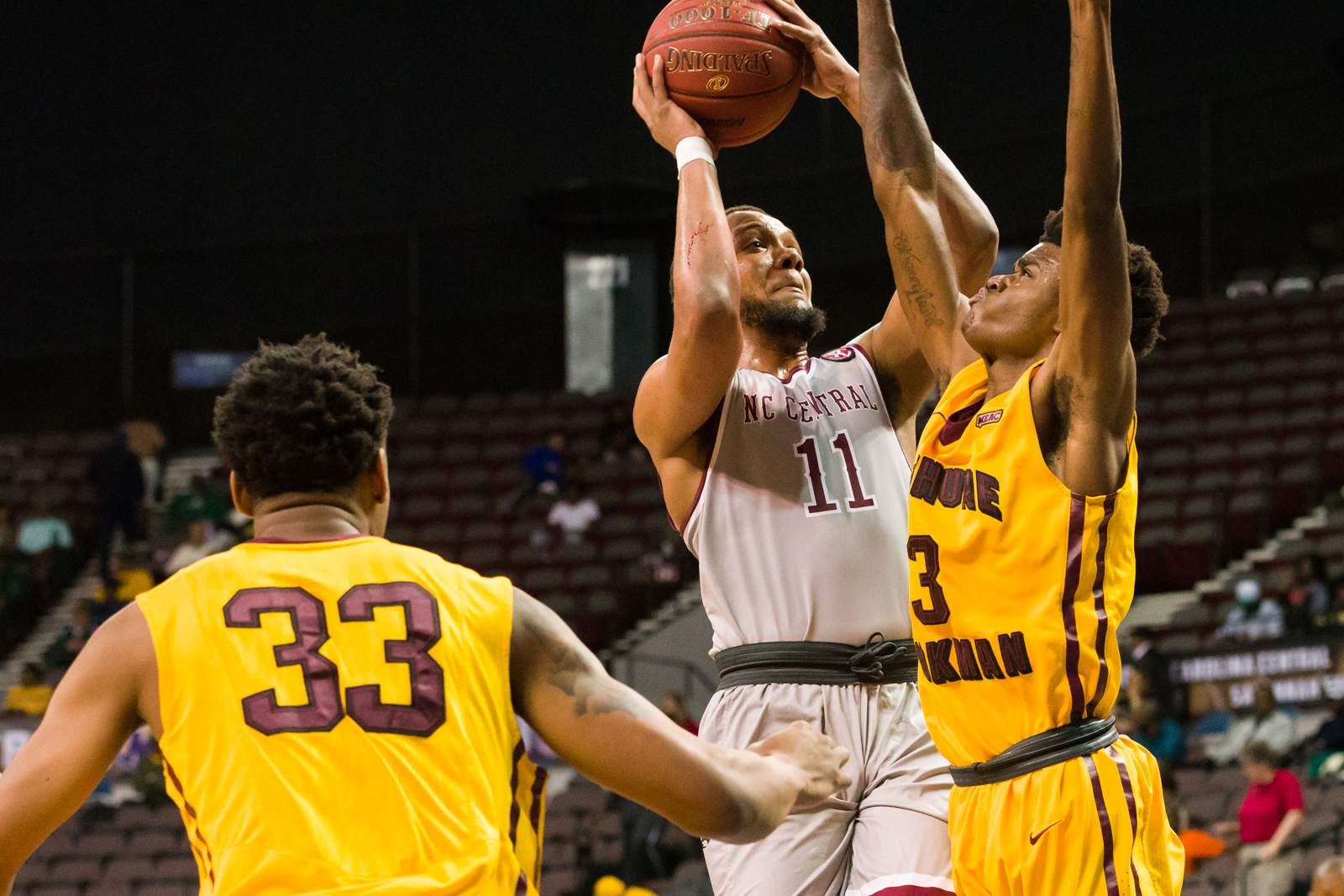 North Carolina Central Eagles guard Patrick Cole (11) goes up for a shot against Bethune-Cookman Wildcats guard Brandon Tabb (3) during the 2017 MEAC Tournament held at the Scope Arena in Norfolk, VA. North Carolina Central defeated Bethune-Cookman 95-60.