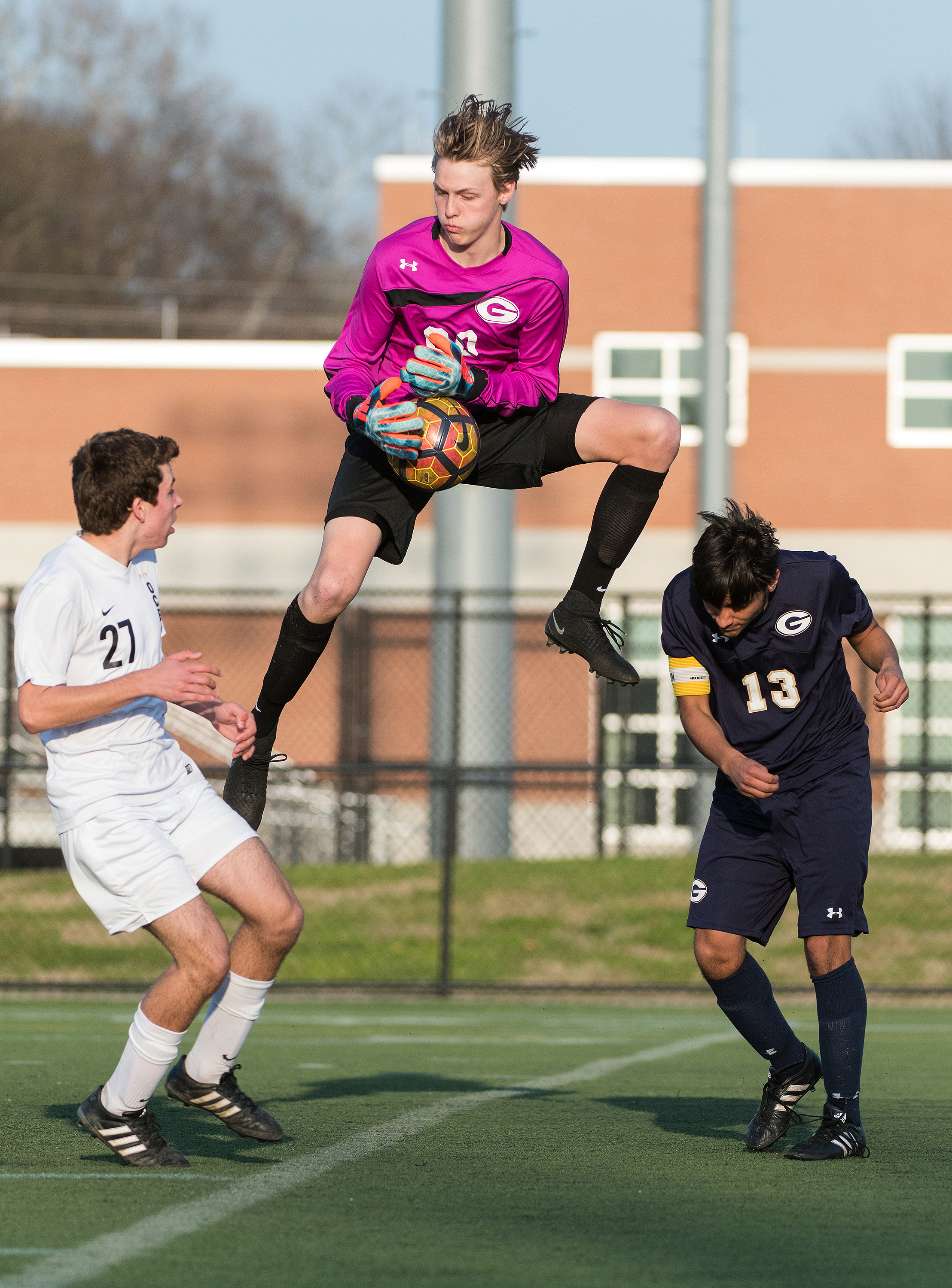 Granby goalkeeper makes a save against Ocean Lakes midfielder Rhys Jones (27) during Friday night's game at Powhatan Field in Norfolk, VA. Ocean Lakes defeated Granby 3-0.