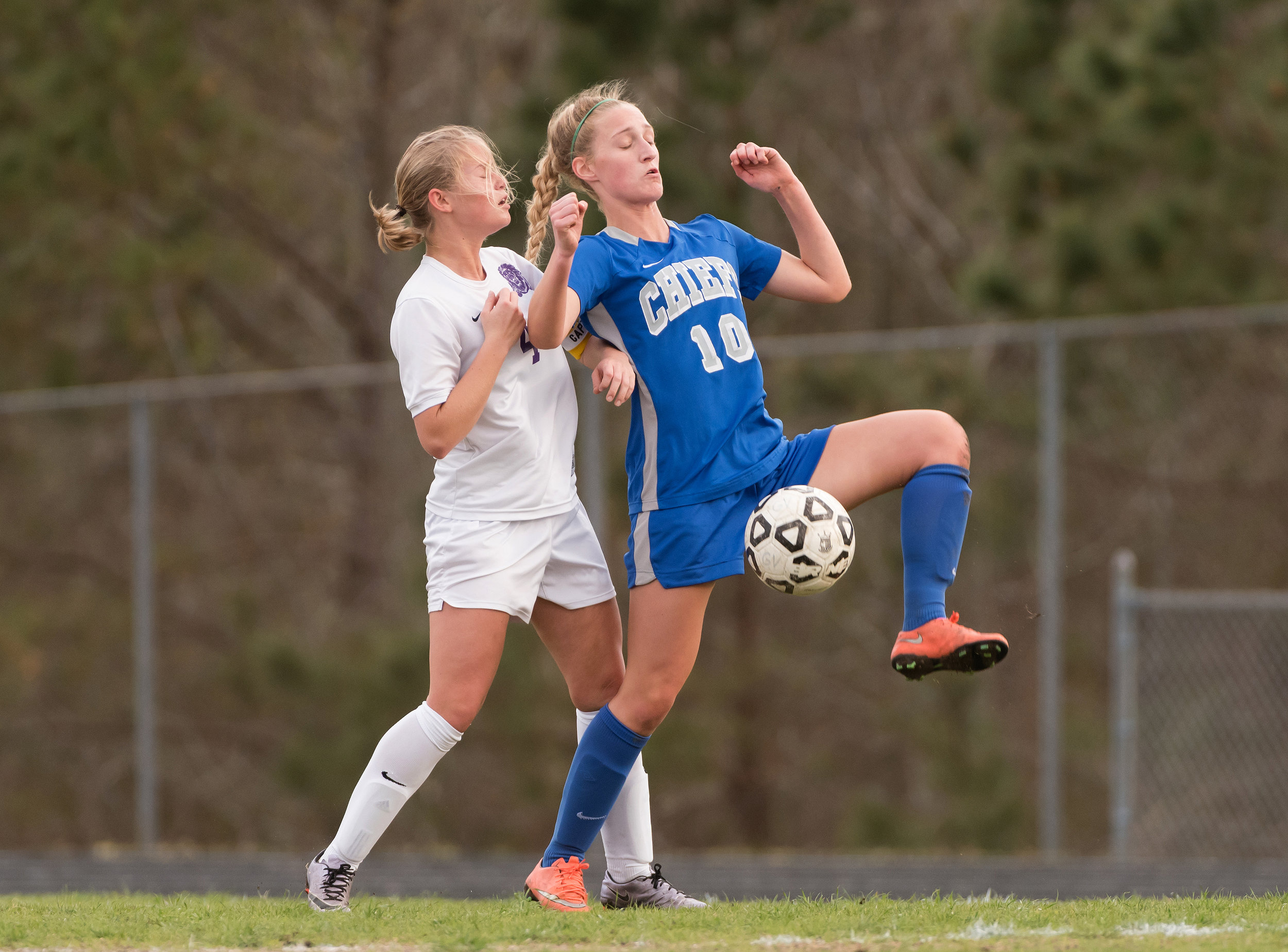 Kempsville midfielder Bethany Fall (10) works to keep the ball away from Tallwood midfielder Haley Rolince (4) during Monday night's game at Tallwood High School. Kempsville defeated Tallwood 2-0.