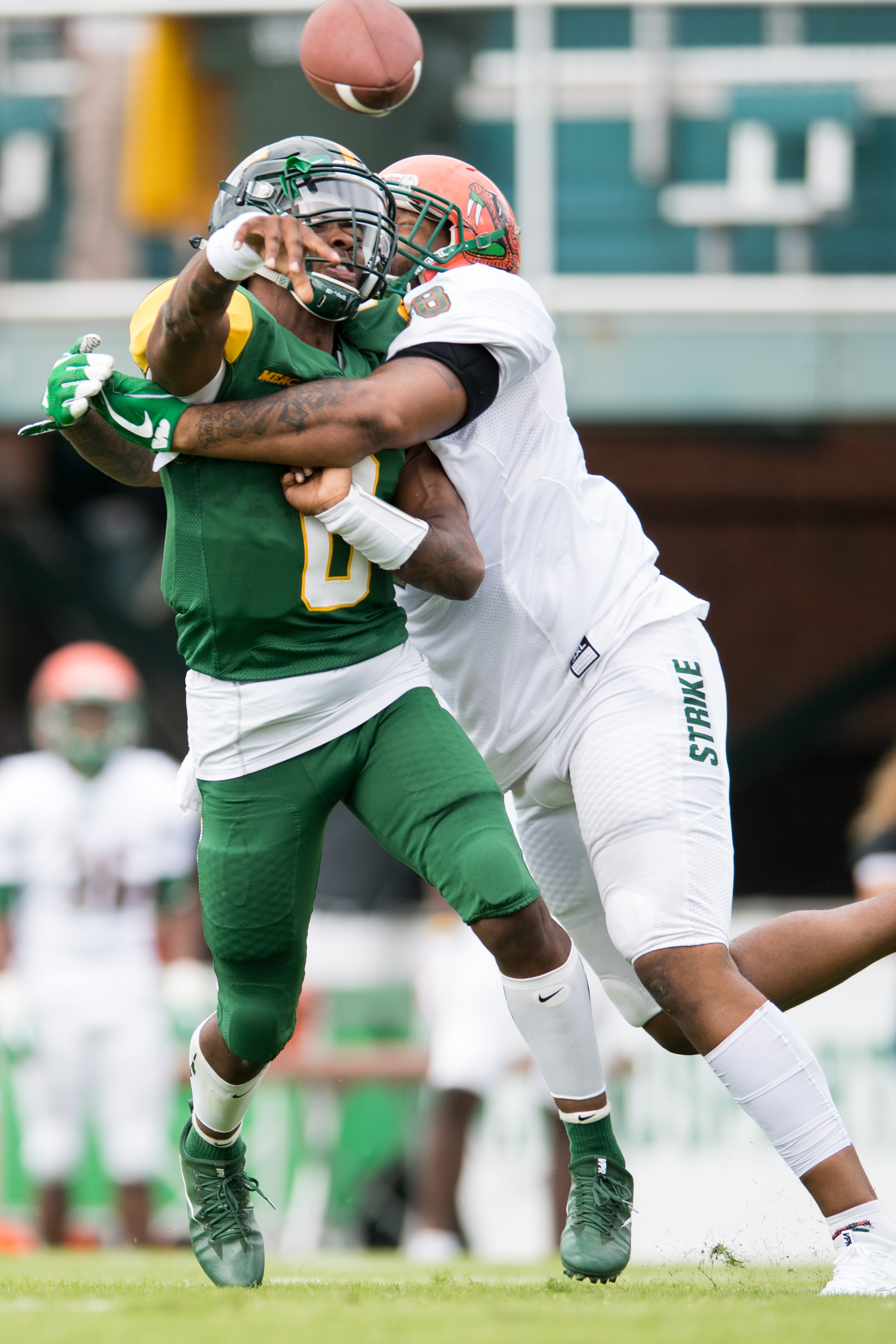 Norfolk State Spartans quarterback Juwan Carter (8) gets hit by Florida A&M Rattlers defensive lineman David Richardson (98) during the Saturday, October 7th 2017 game held at Dick Price Stadium in Norfolk, Virginia. Score is tied 14-14 at the half.