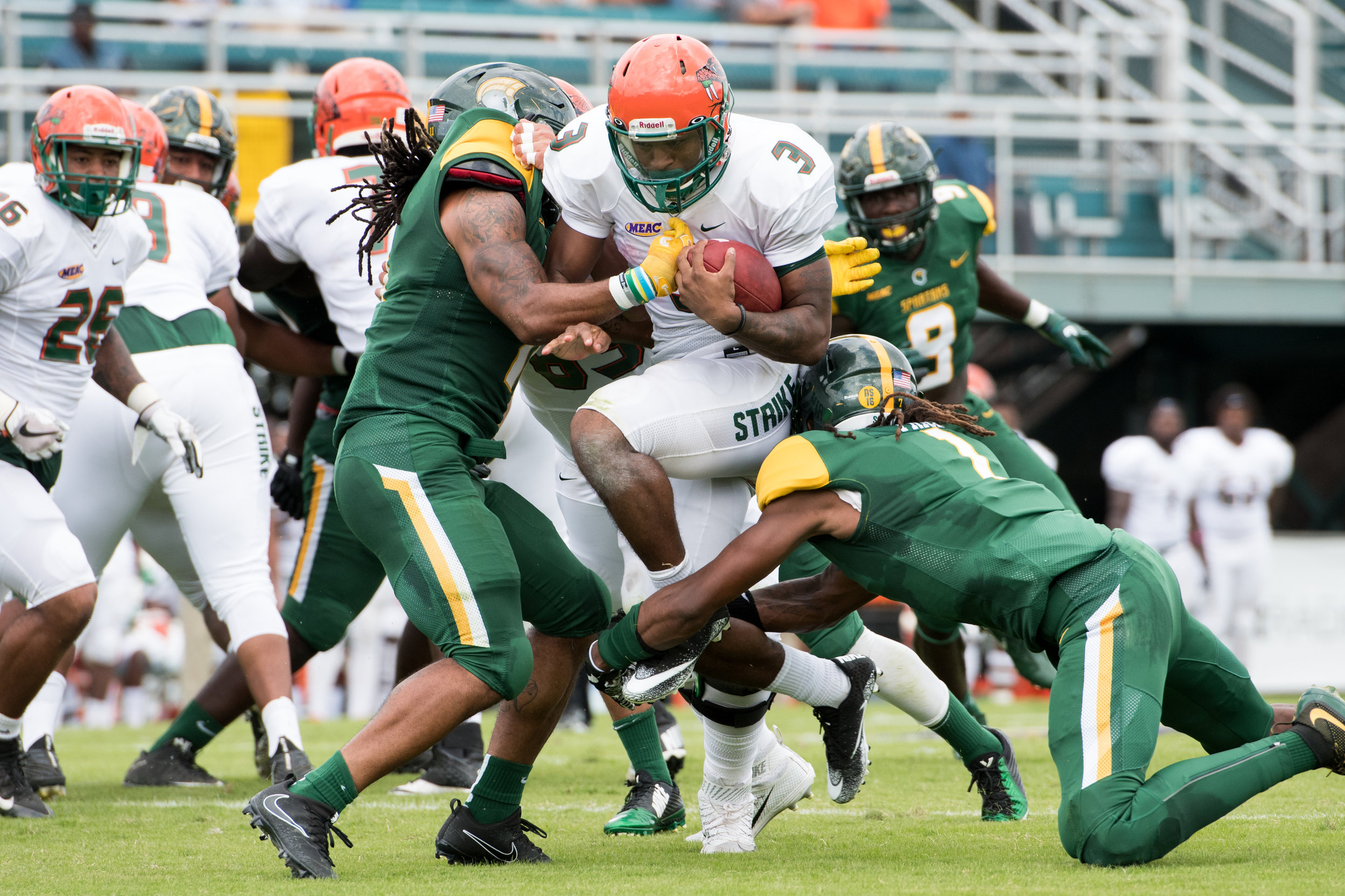 Florida A&M Rattlers running back Azende Rey (3) gets tackled by Norfolk State Spartans defensive back Bobby Price (1) during the Saturday, October 7th 2017 game held at Dick Price Stadium in Norfolk, Virginia. Score is tied 14-14 at the half.