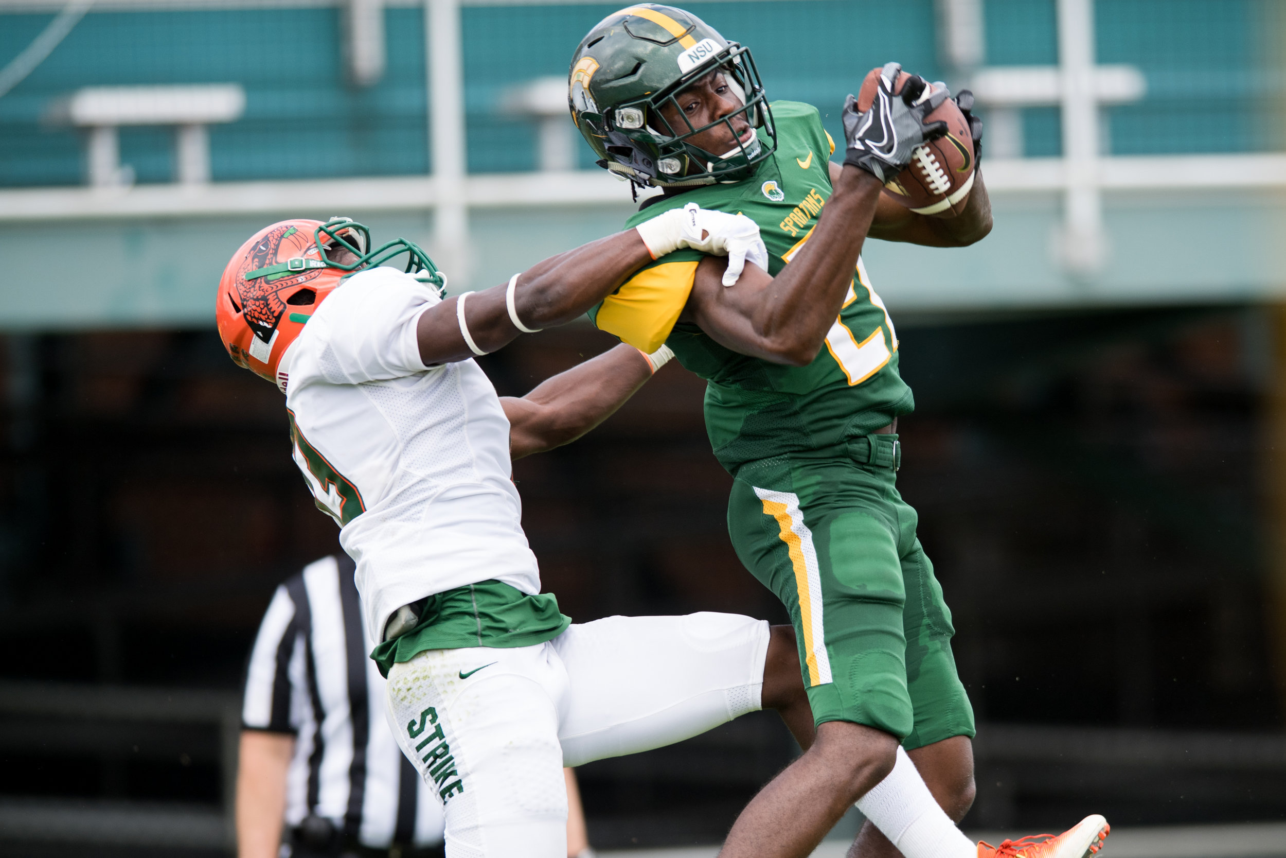 Norfolk State Spartans wide receiver George Wahee (21) catches a touchdown pass against Florida A&M Rattlers defensive back Jules Dornevil (13) during the Saturday, October 7th 2017 game held at Dick Price Stadium in Norfolk, Virginia. Score is tied 14-14 at the half.