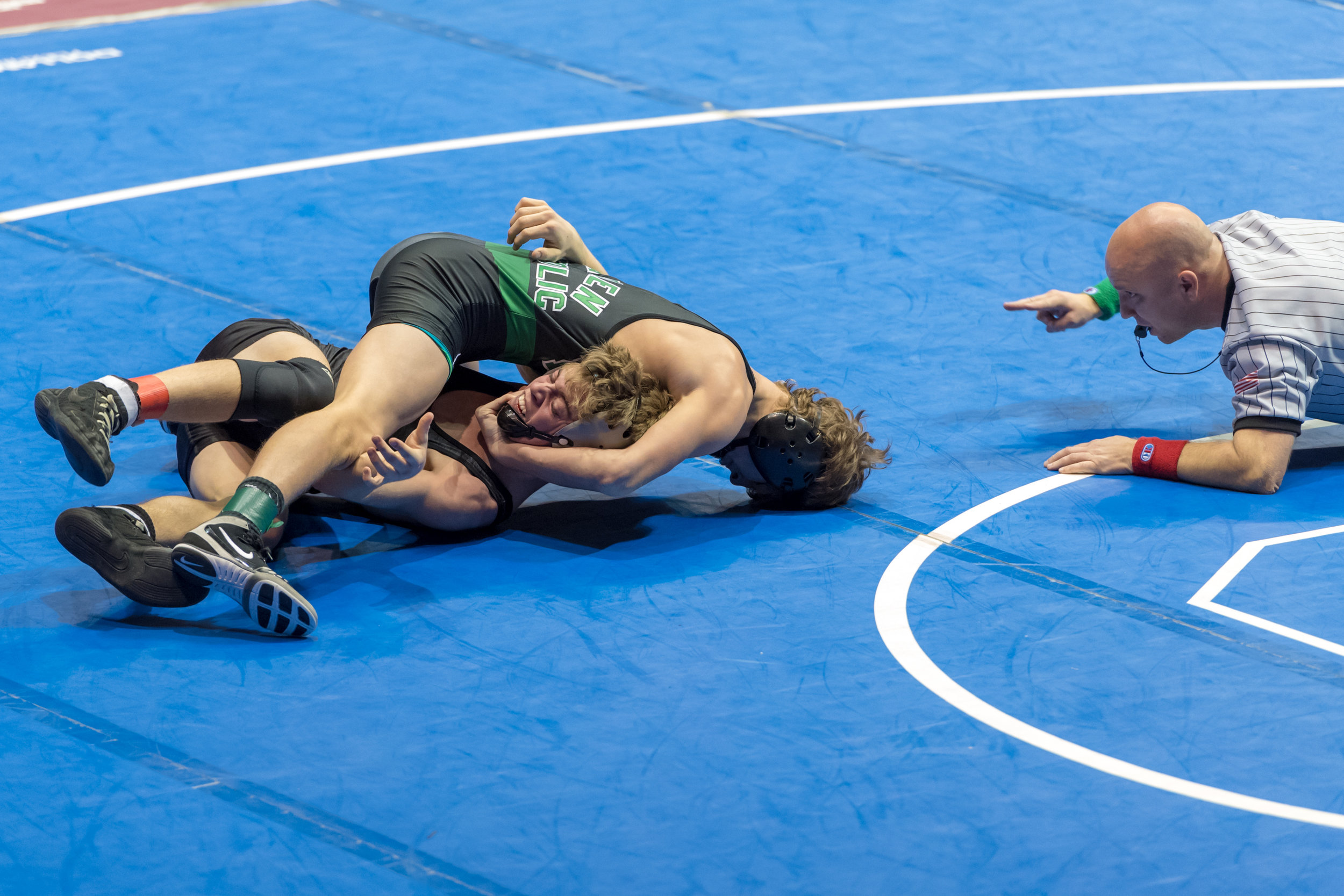 Kellam's Luke Little works to escape from Camden Catholic's Lucas Revano during the 132 pound match at the  Virginia Duals held January 13, 2018 at the Hampton Coliseum. Camden Catholic defeated Kellam 39 - 19.