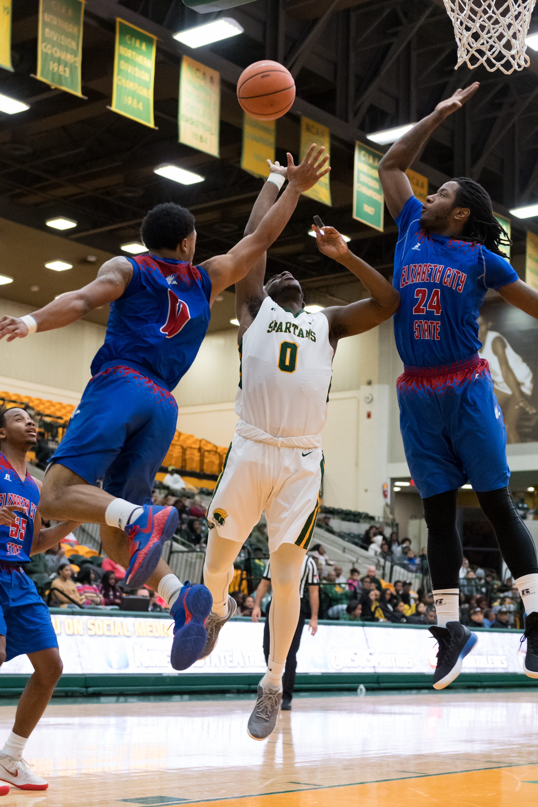 Norfolk State Spartans guard Mastadi Pitt goes up for a shot under pressure from Elizabeth City State Vikings guard Zaccheus Hobbs and forward Charles Woods during the Monday, January 15, 2018 game. The Vikings defeated the Spartans 76 to 67.