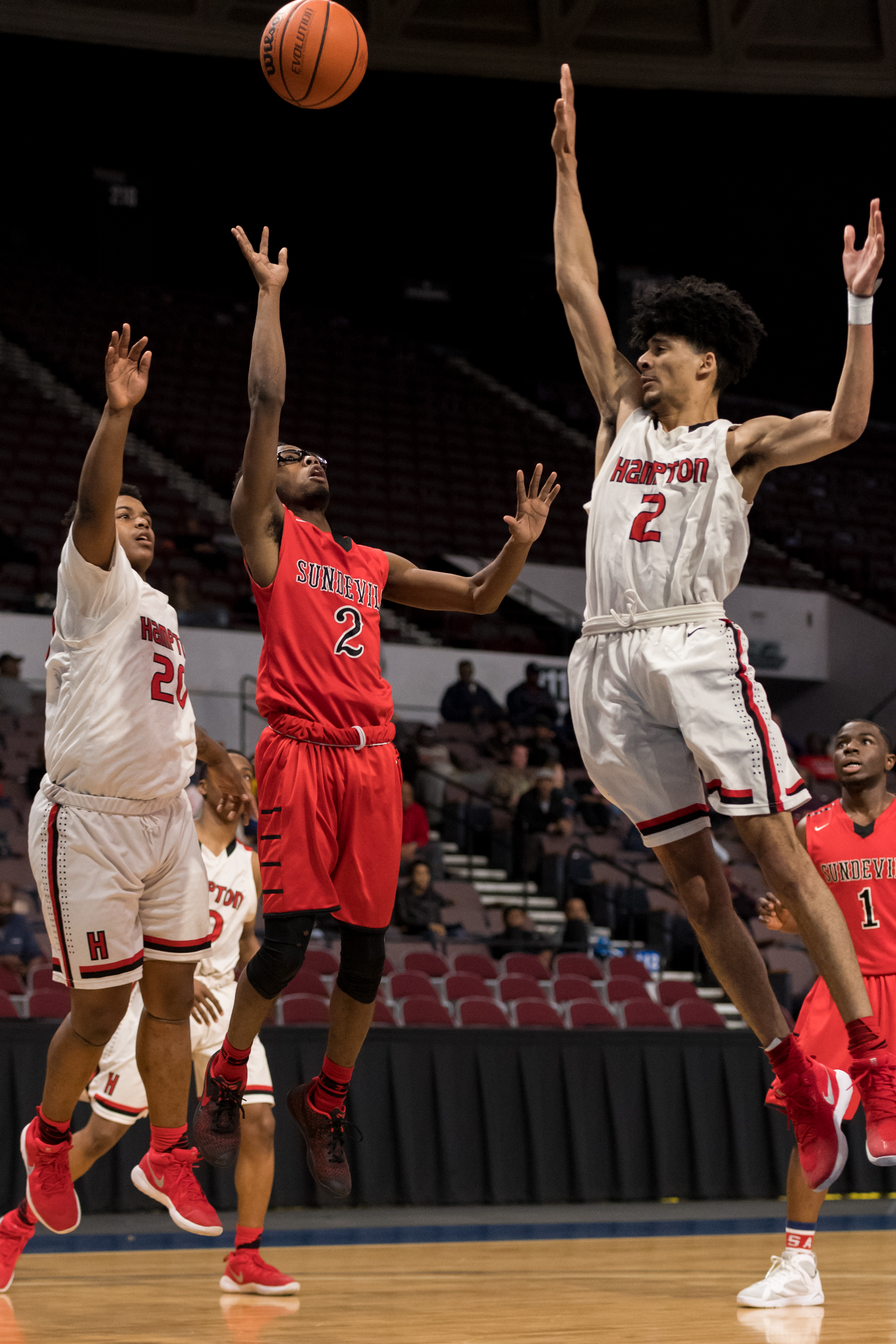 Salem guard Kymon Tyson takes a shot against Hampton forward Jacquez Yow and guard Khairig Grogins during the Region 5A Championship game held Monday, February 26, 2018 at the Norfolk Scope. Salem leads Hampton 30 to 26 at half time.