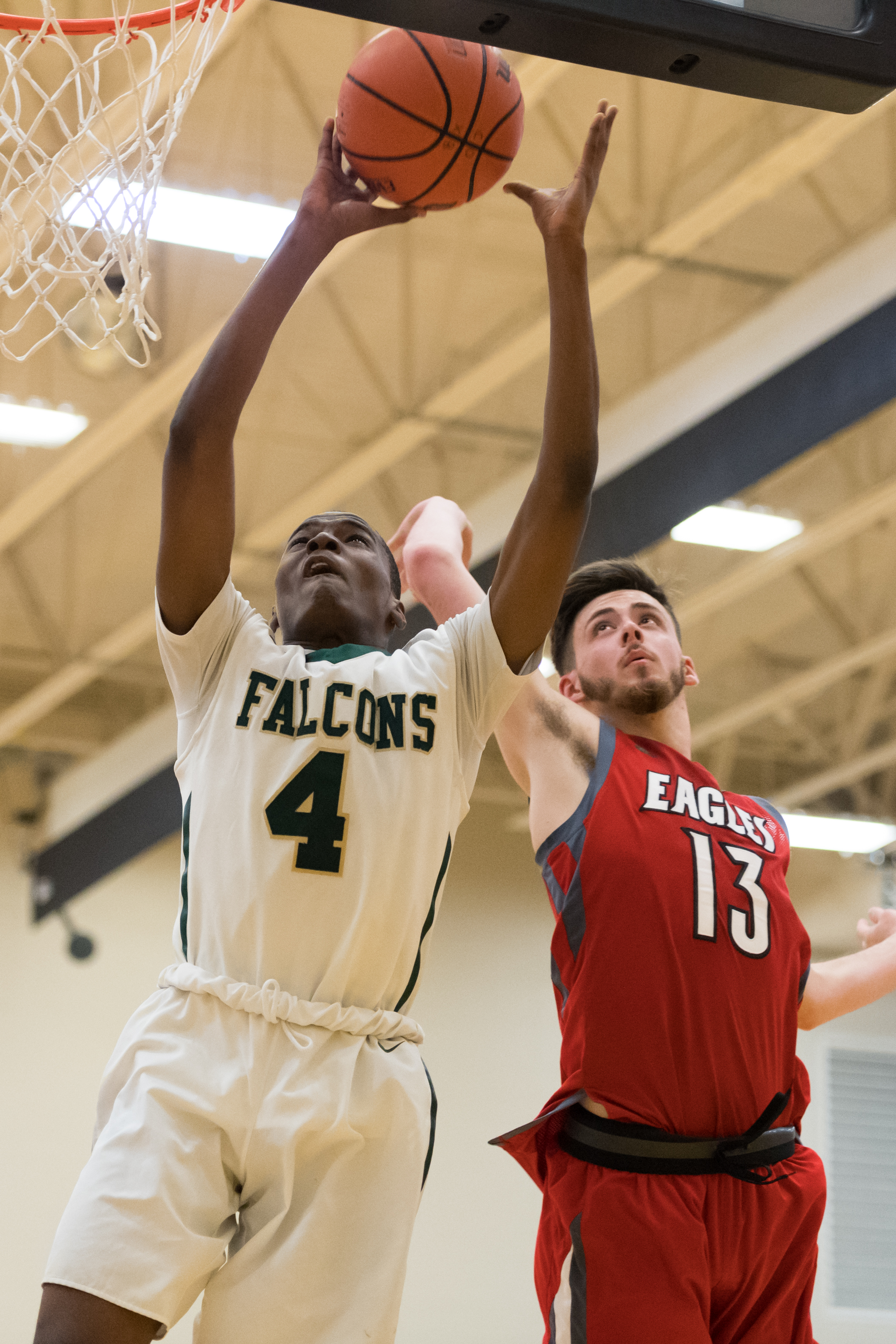 Cox's Deshawn Creighton takes a shot under pressure from Franklin's Nathan Brooks during the Saturday, March 3, 2018 game held at Kellam High School.