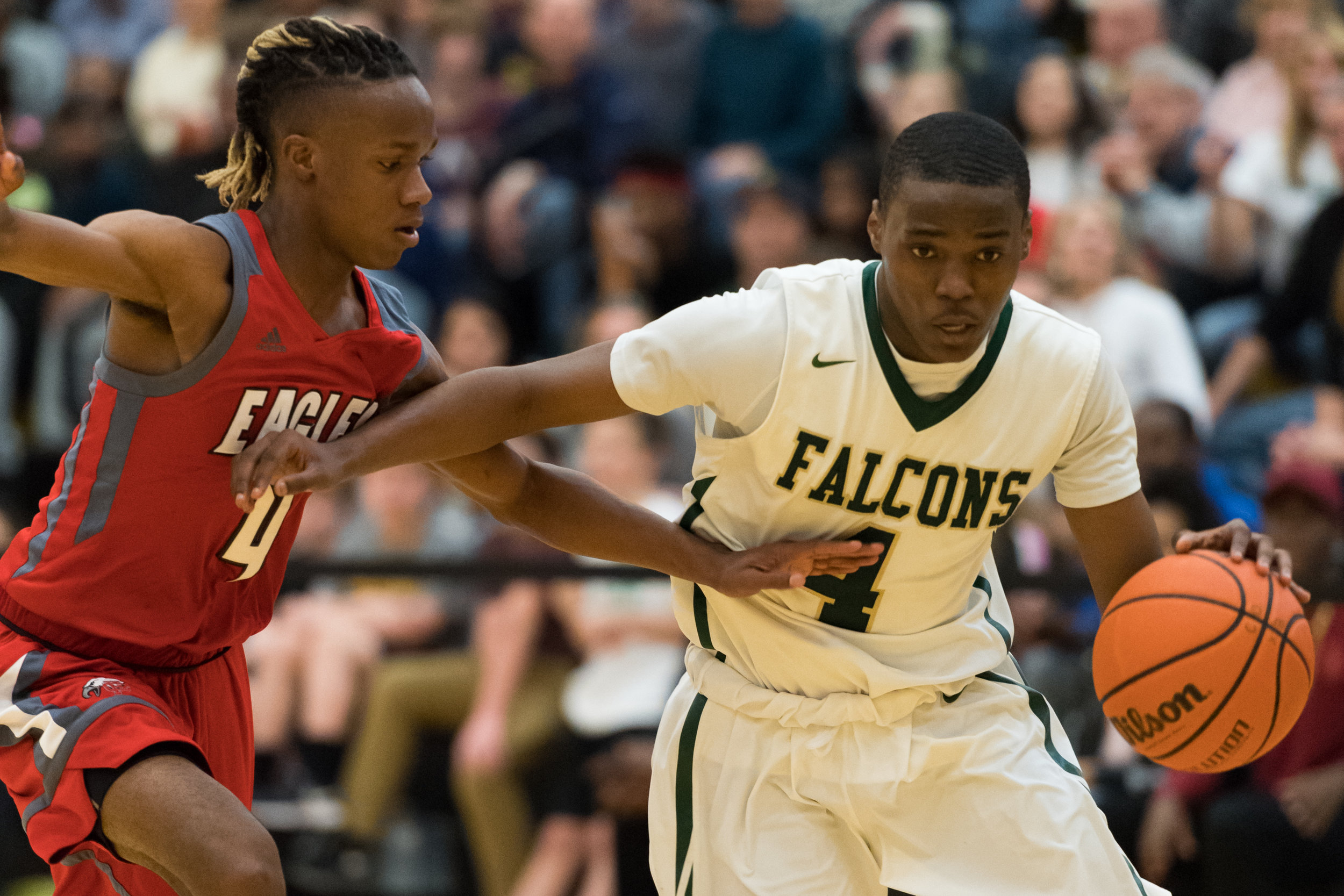 Cox's Deshawn Creighton drives towards the basket under pressure from Franklin's Chandler Taylor during the Saturday, March 3, 2018 game held at Kellam High School.