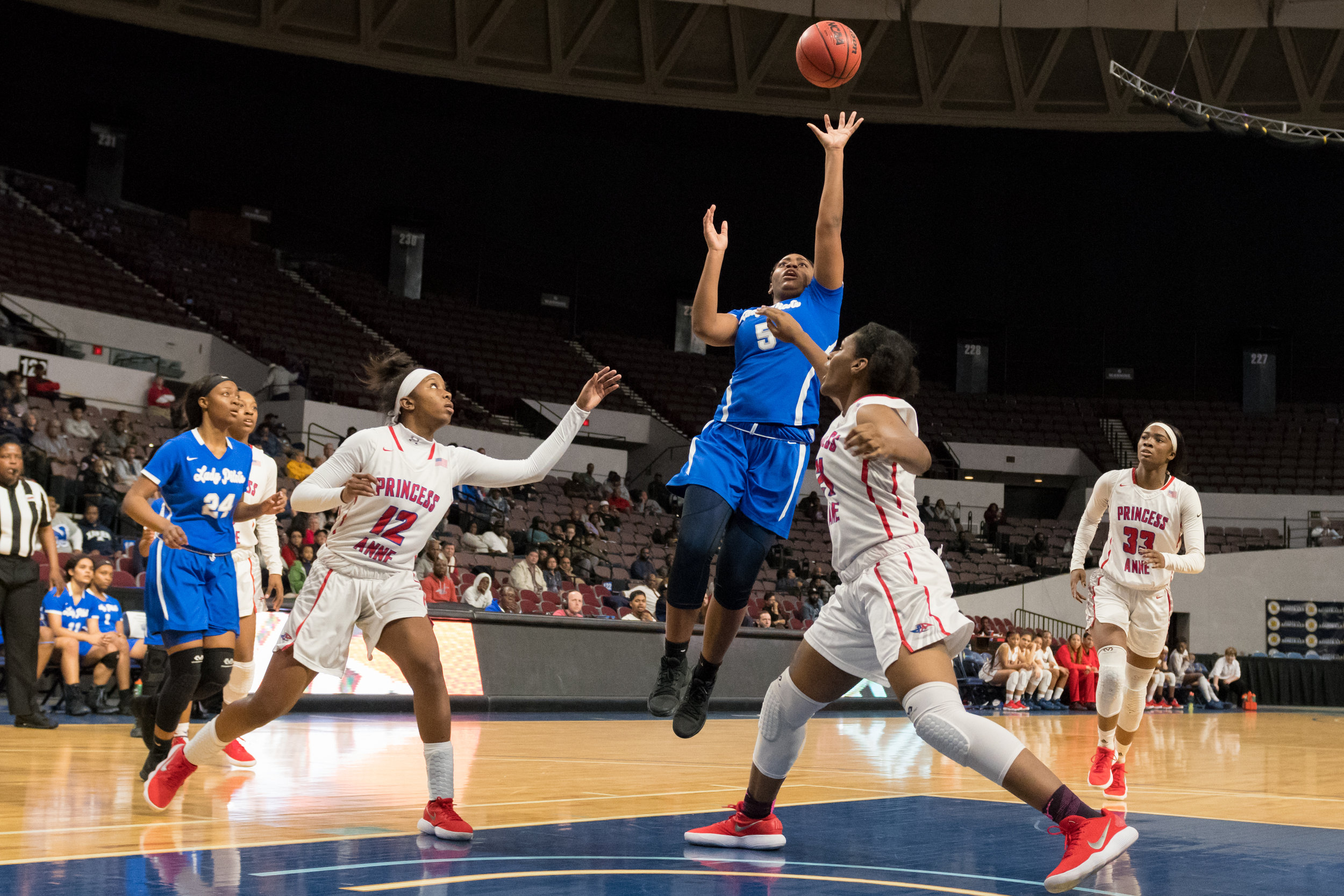 Norview's Janiya Gullibux goes up for a shot against Princess Anne's Bryonna Ferebee and Brianna Jackson during the Region 5A Championship game held Monday, February 26, 2018 at the Norfolk Scope. Princess Anne defeated Norview 61 to 40.