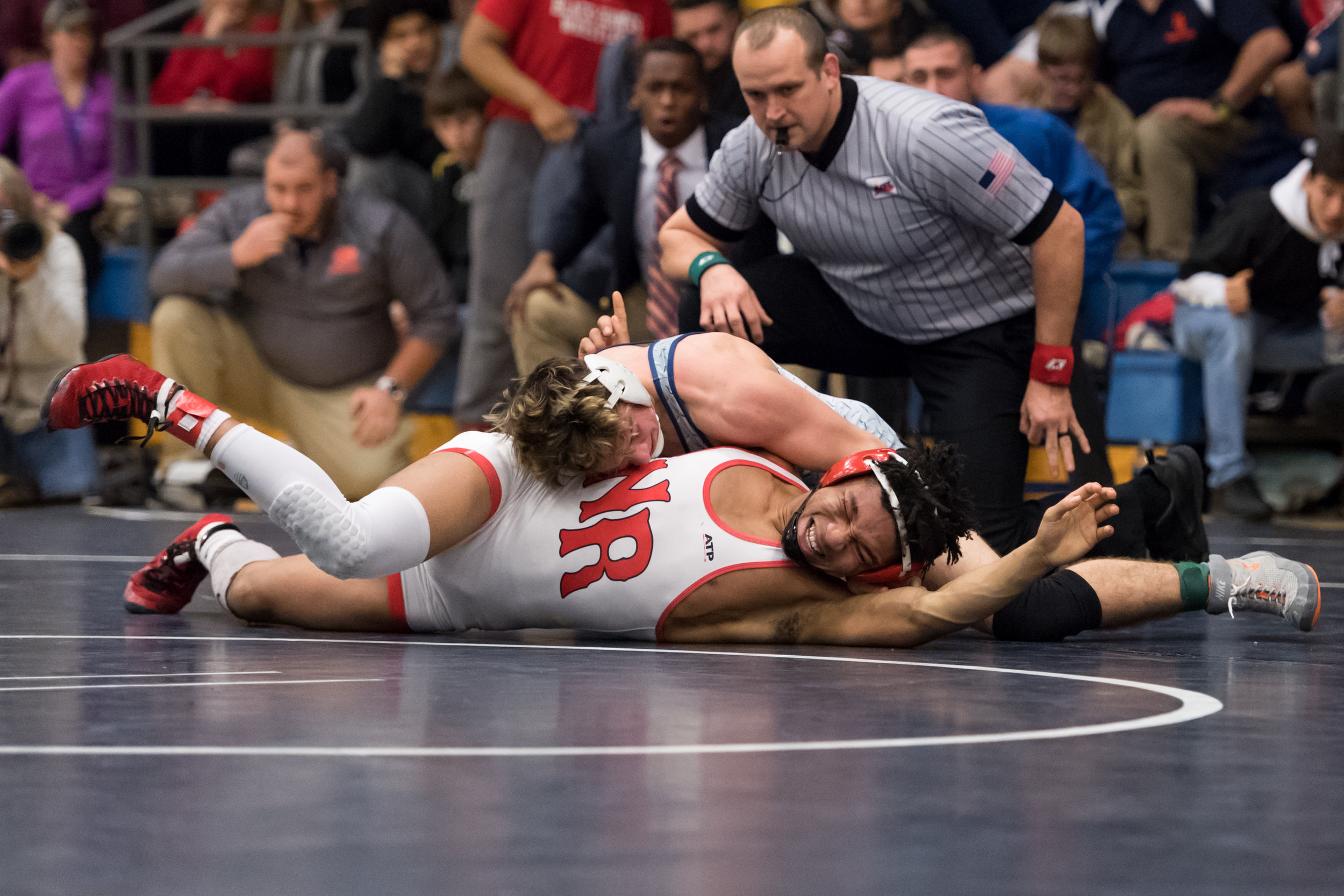 Nansemond River's Elijah Williams works to escape North Stafford's Julio Alegeria during the 145 pound match at the VHSL Region 5 State Championship held on Saturday, February 17, 2018 at Oscar Smith High School. Williams placed 2nd in the state championship.