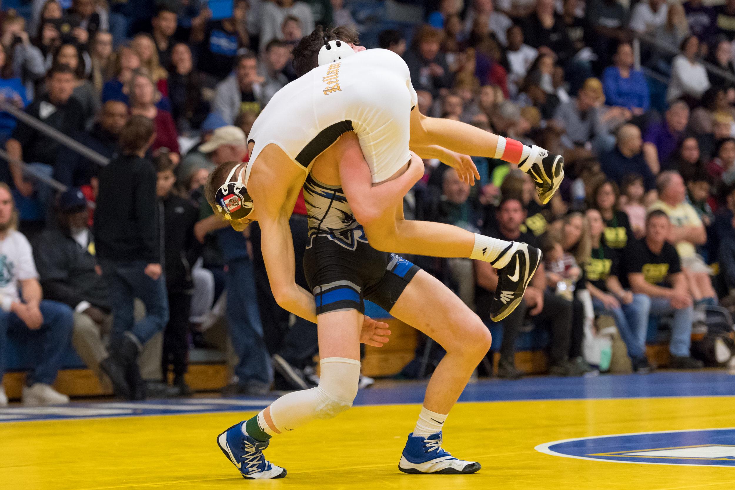 Landstown's Bryce Sanderlin picks up Kellam's Garrett Schrantz during the 126 pound match at the VHSL Region 6 State Championship held on Saturday, February 17, 2018 at Oscar Smith High School. Sanderlin won the 126 pound state championship.