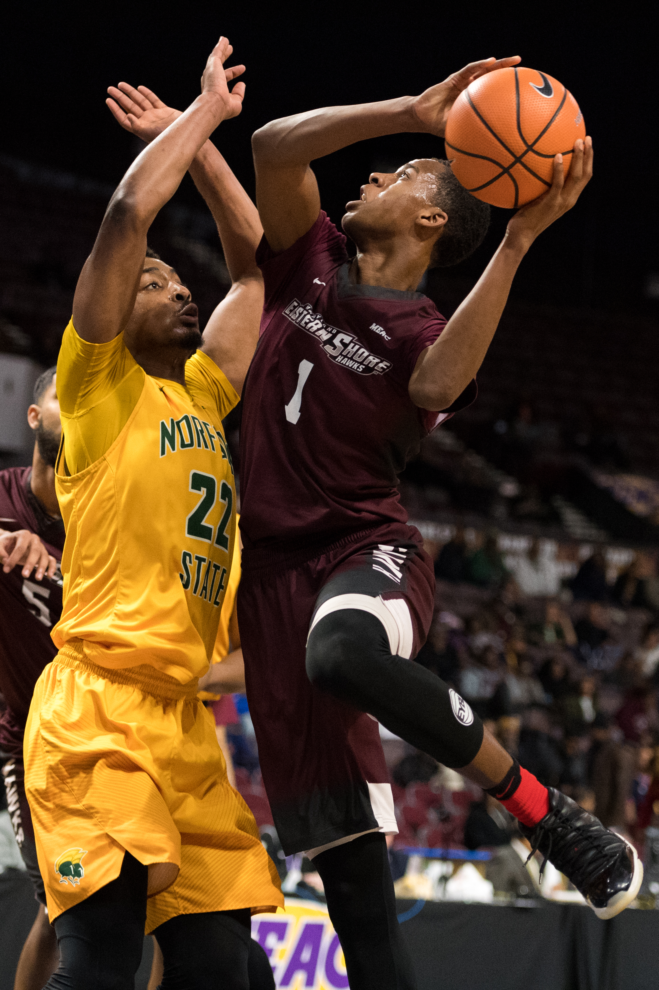 Maryland-Eastern Shore Hawks forward Miryne Thomas (1) takes a shot against Norfolk State Spartans forward Alex Long (22) during the Monday, March 5, 2018 game held at Norfolk Scope Arena.