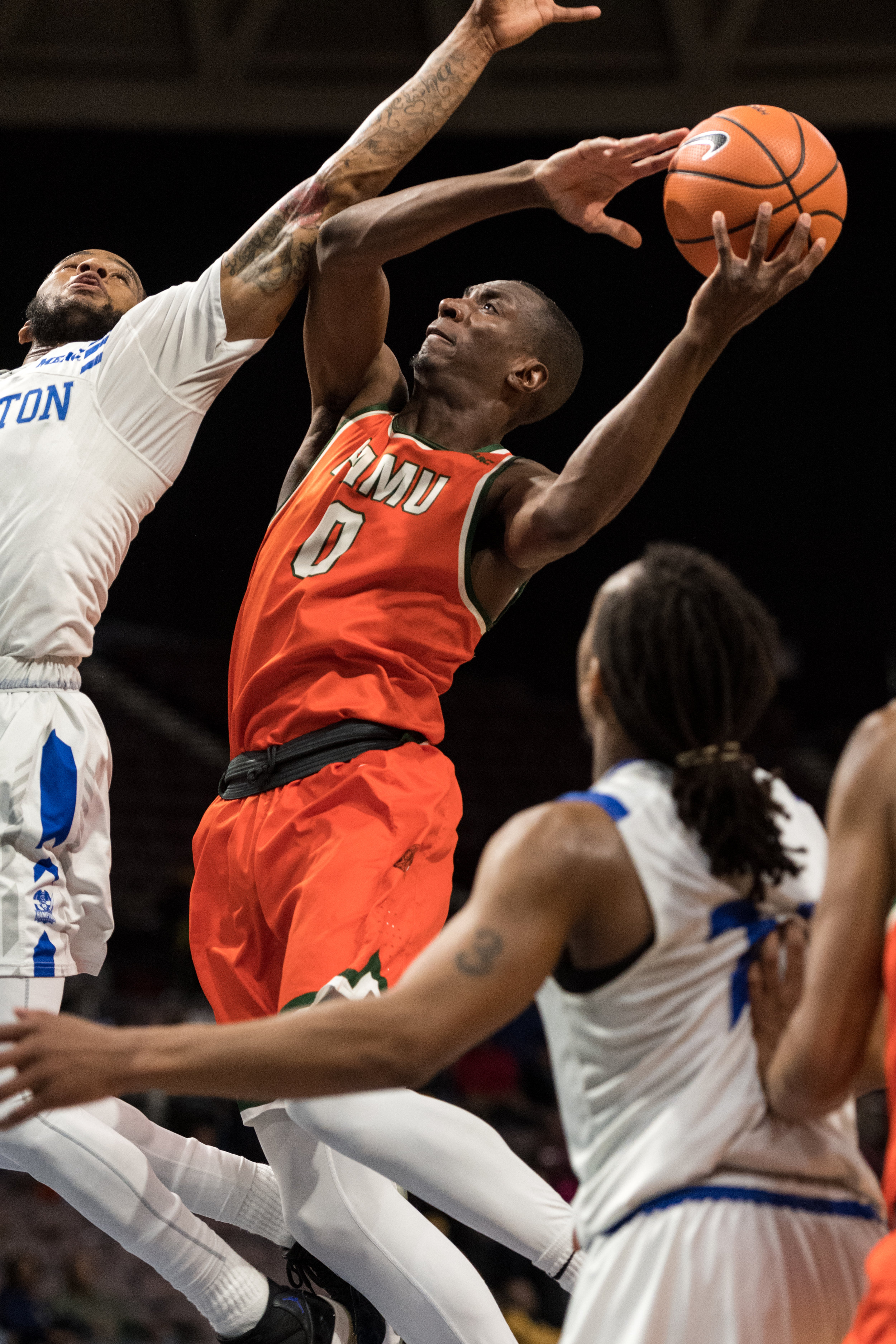 Florida A&M Rattlers forward Desmond Williams (0) takes a shot under pressure from Hampton Pirates guard Malique Trent-Street (1) during the Wednesday, March 7, 2018 game held at Norfolk Scope Arena. Hampton defeated Florida A&M 75 to 71.