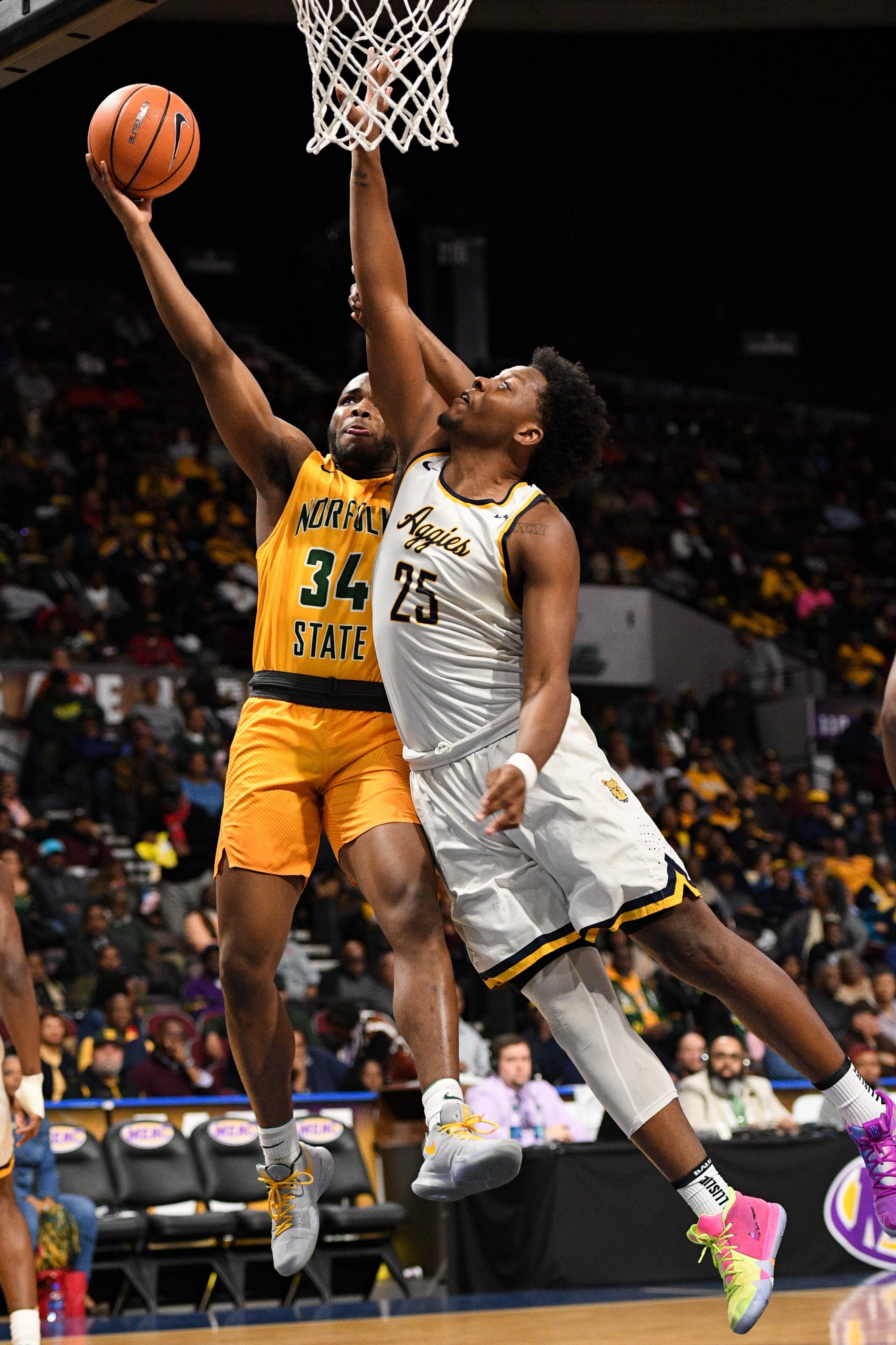 Norfolk State Spartans guard Steven Whitley goes up for a shot against North Carolina A&T Aggies forward Femi Olujobi during the Thursday, March 8, 2018 game held at Norfolk Scope Arena.