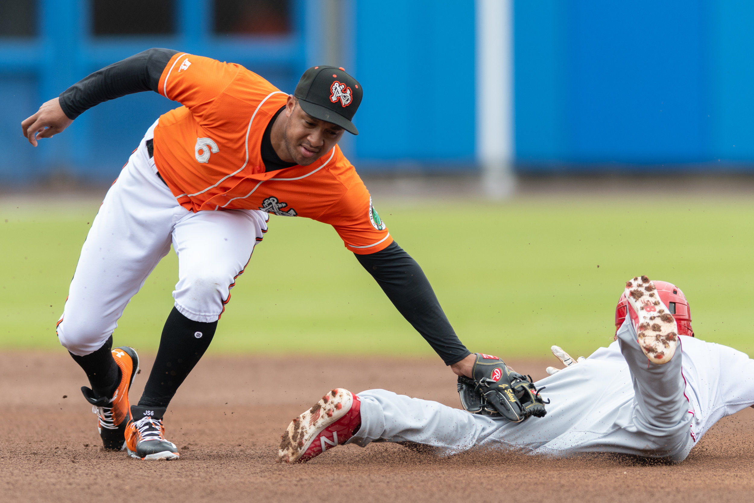 Norfolk Tides second baseman Jonathan Schoop goes for a tag-out at second base against the Louisville Bats during the Sunday, May 6, 2018 game at Harbor Park. The Tides defeated the Bats 2 - 1.