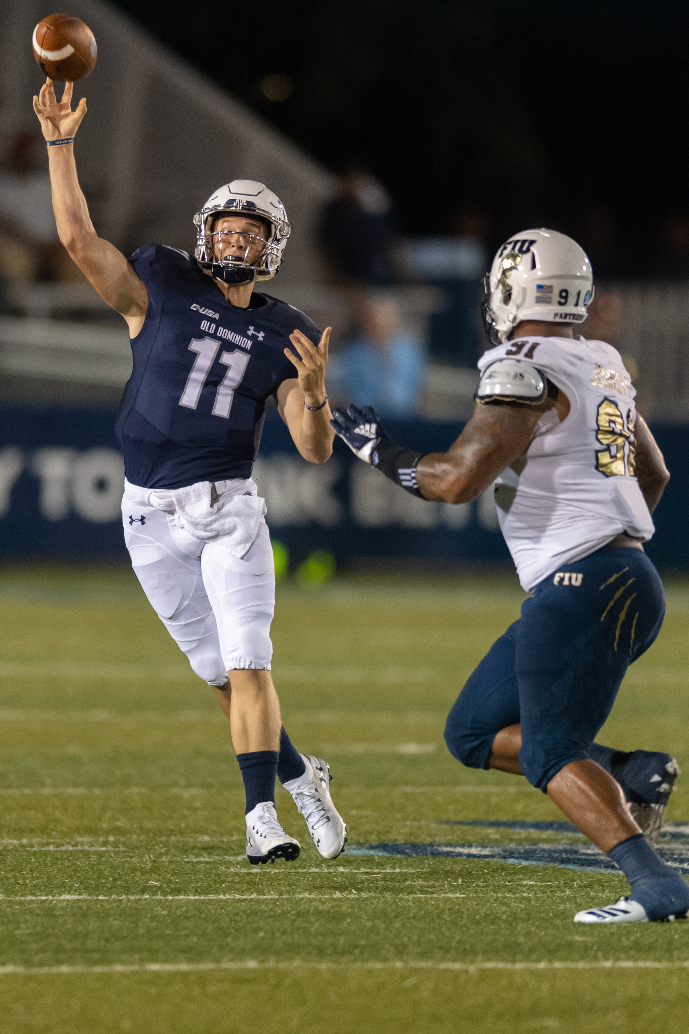 Old Dominion Monarchs quarterback Blake LaRussa (11) makes a pass under pressure from FIU Panthers defensive lineman Anthony Johnson (91) during the Saturday, Sept. 8, 2018 game held at Old Dominion University in Norfolk, Virginia. The Monarchs lead 14 to 0 during the second quarter.