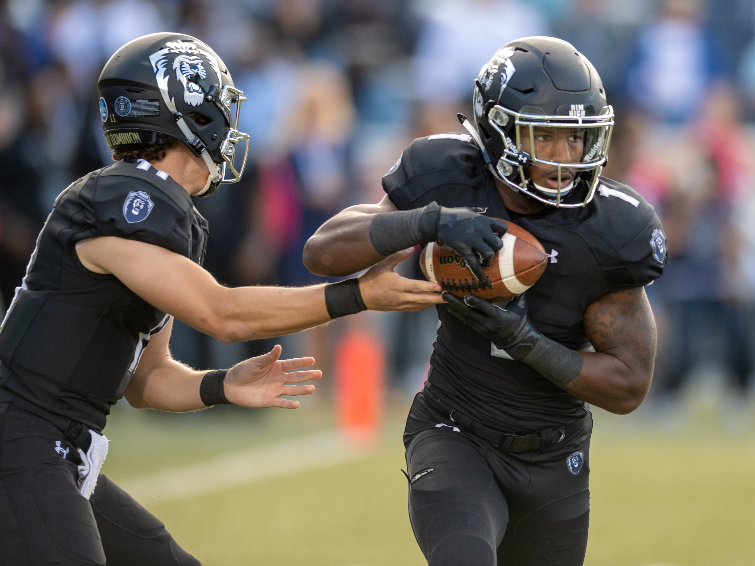 Old Dominion Monarchs running back Kesean Strong (1) takes a handoff from quarterback Blake LaRussa (11) during the Saturday, Oct. 13, 2018 game against the Marshall Thundering Herd held at Old Dominion University in Norfolk, Virginia. Marshall leads Old Dominion 14 to 3 at halftime.