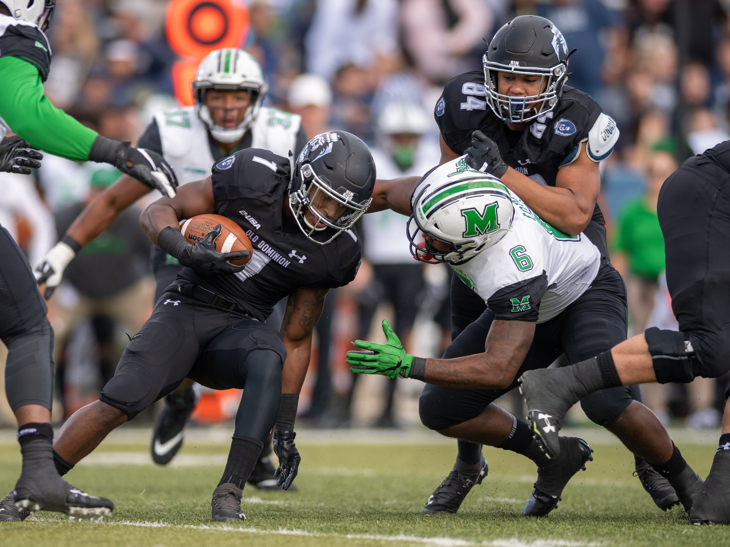 Marshall Thundering Herd defensive lineman Marquis Couch (6) works to tackle Old Dominion Monarchs running back Kesean Strong (1) during the Saturday, Oct. 13, 2018 game held at Old Dominion University in Norfolk, Virginia. Marshall leads Old Dominion 14 to 3 at halftime.