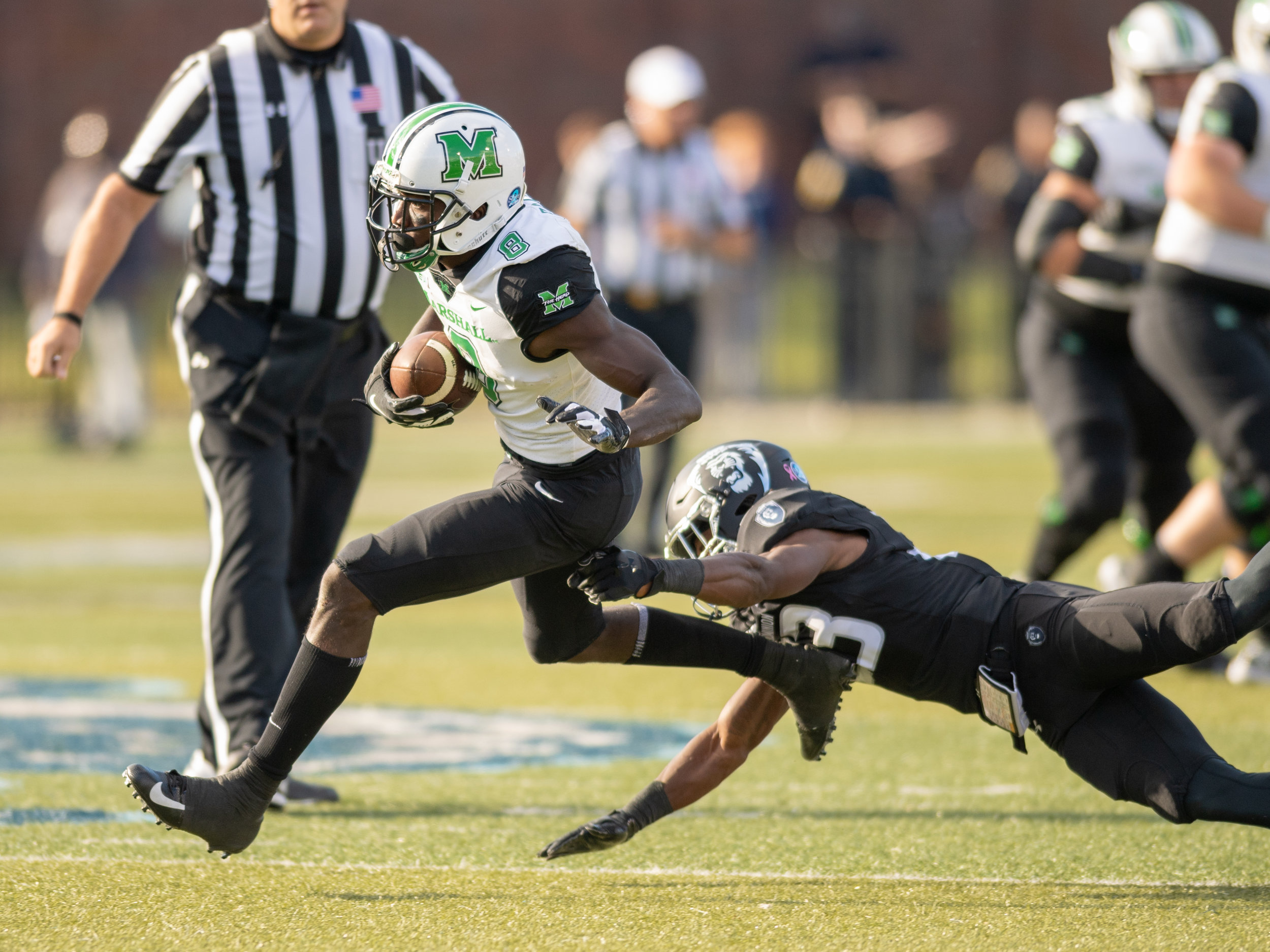 Marshall Thundering Herd wide receiver Tyre Brady (8) escapes a tackle by Old Dominion Monarchs cornerback Geronda Hall (23) during the Saturday, Oct. 13, 2018 game held at Old Dominion University in Norfolk, Virginia. Marshall leads Old Dominion 14 to 3 at halftime.