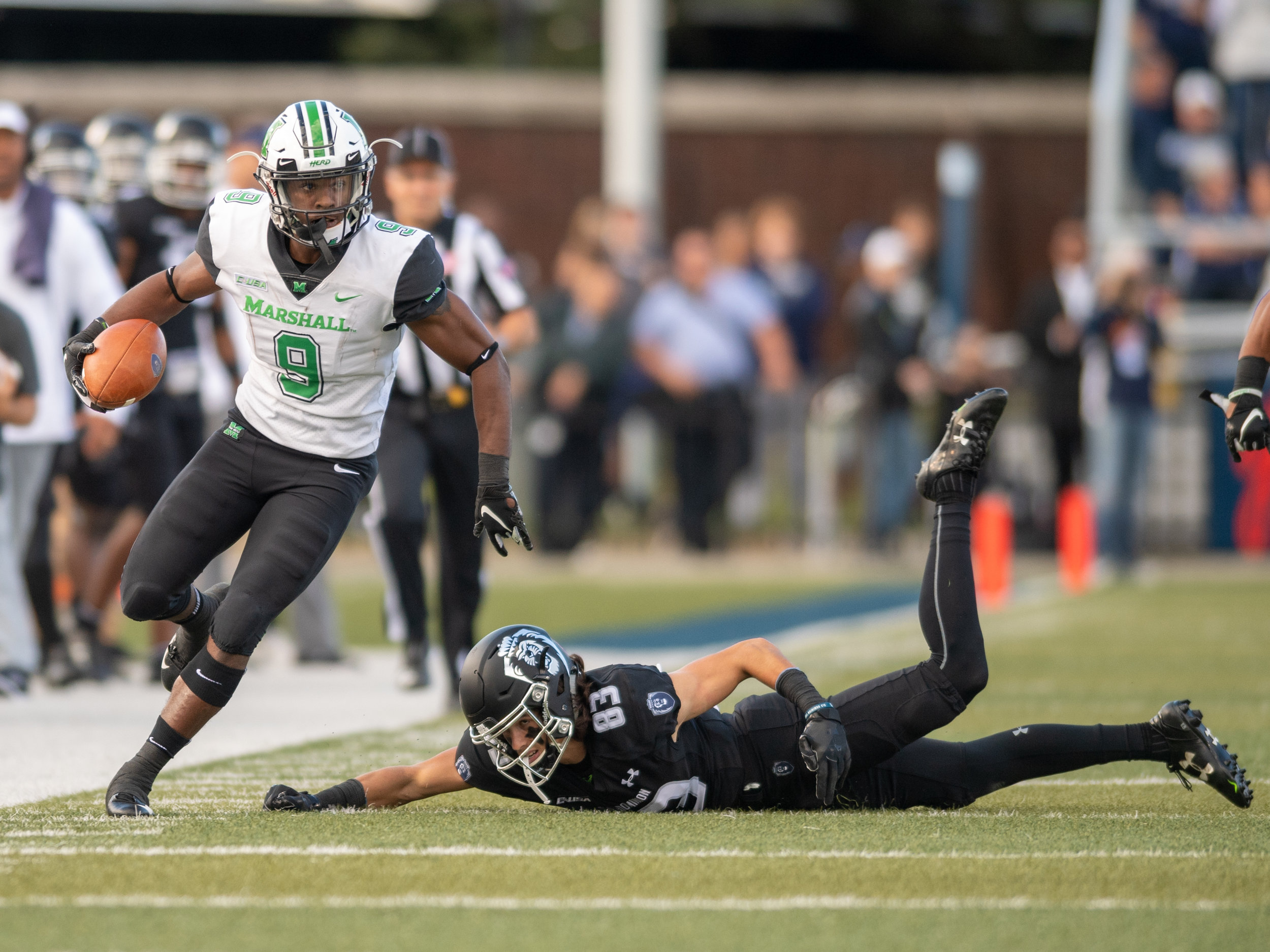 Marshall Thundering Herd wide receiver Marcel Williams (9) avoids a tackle by Old Dominion Monarchs wide receiver Jake Herslow (83) during the Saturday, Oct. 13, 2018 game held at Old Dominion University in Norfolk, Virginia. Marshall leads Old Dominion 14 to 3 at halftime.