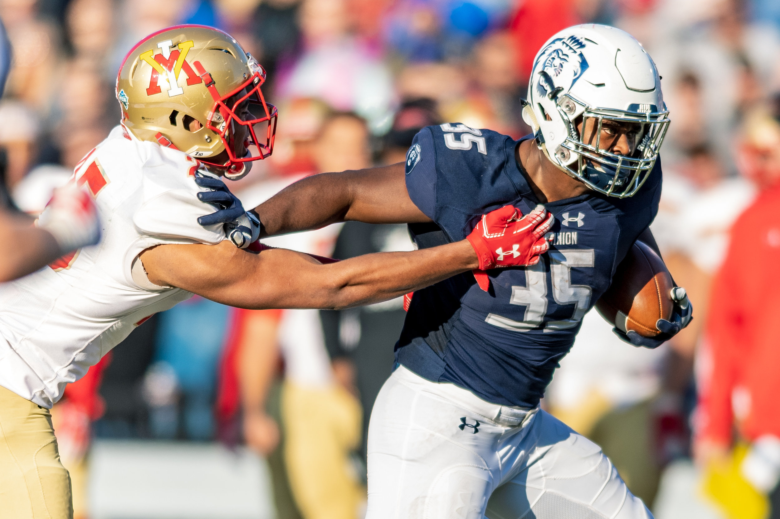 Old Dominion Monarchs running back Jeremy Cox (35) stiff arms Virginia Military Institute Keydets defensive back A.J. Smith (25) during the Saturday, Nov. 17, 2018 game held at Old Dominion University in Norfolk, Virginia. Old Dominion leads VMI 49 to 0 at halftime.