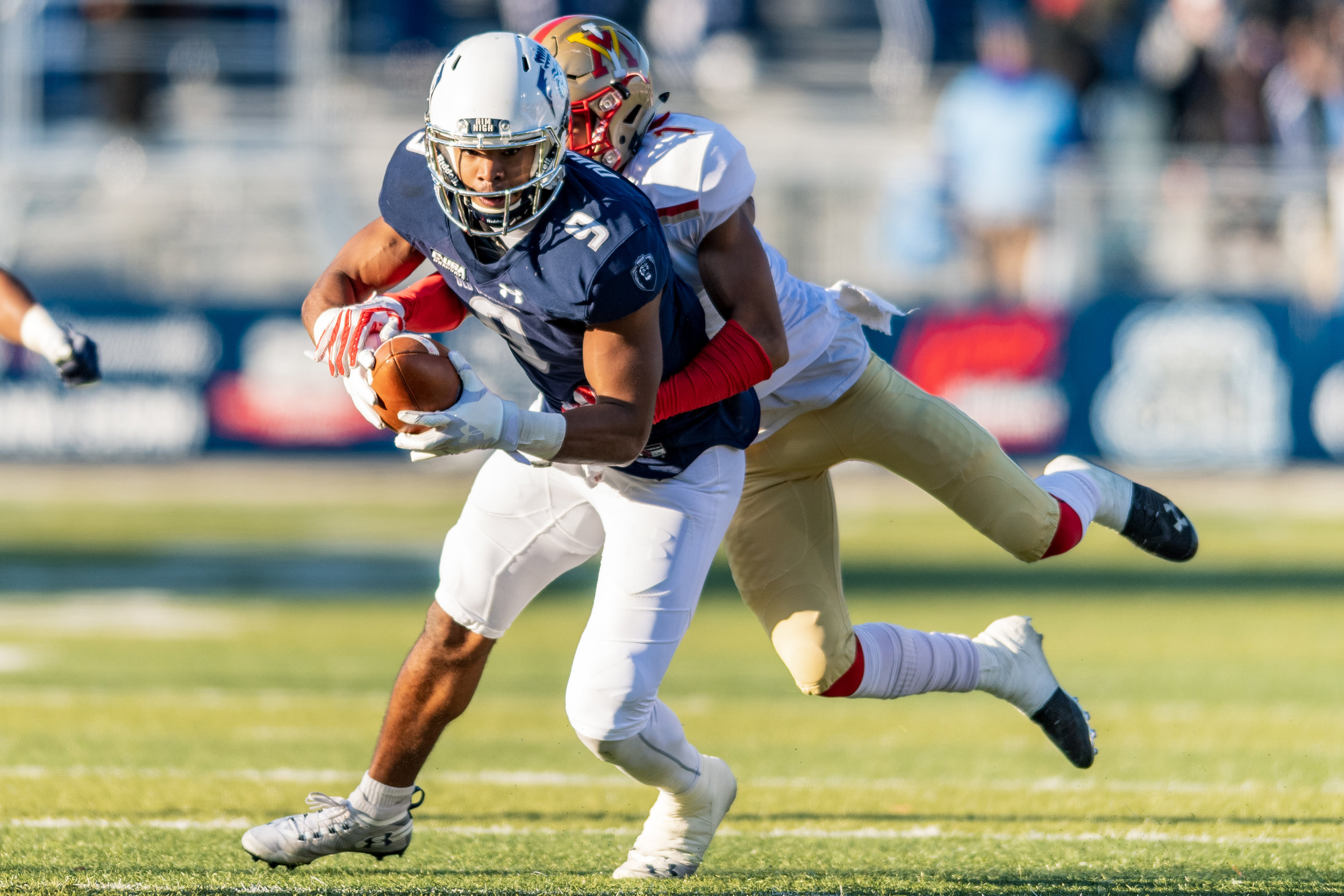 Virginia Military Institute Keydets defensive back Kaleb Tucker (1) works to tackle Old Dominion Monarchs wide receiver Jonathan Duhart (9) during the Saturday, Nov. 17, 2018 game held at Old Dominion University in Norfolk, Virginia. Old Dominion leads VMI 49 to 0 at halftime.
