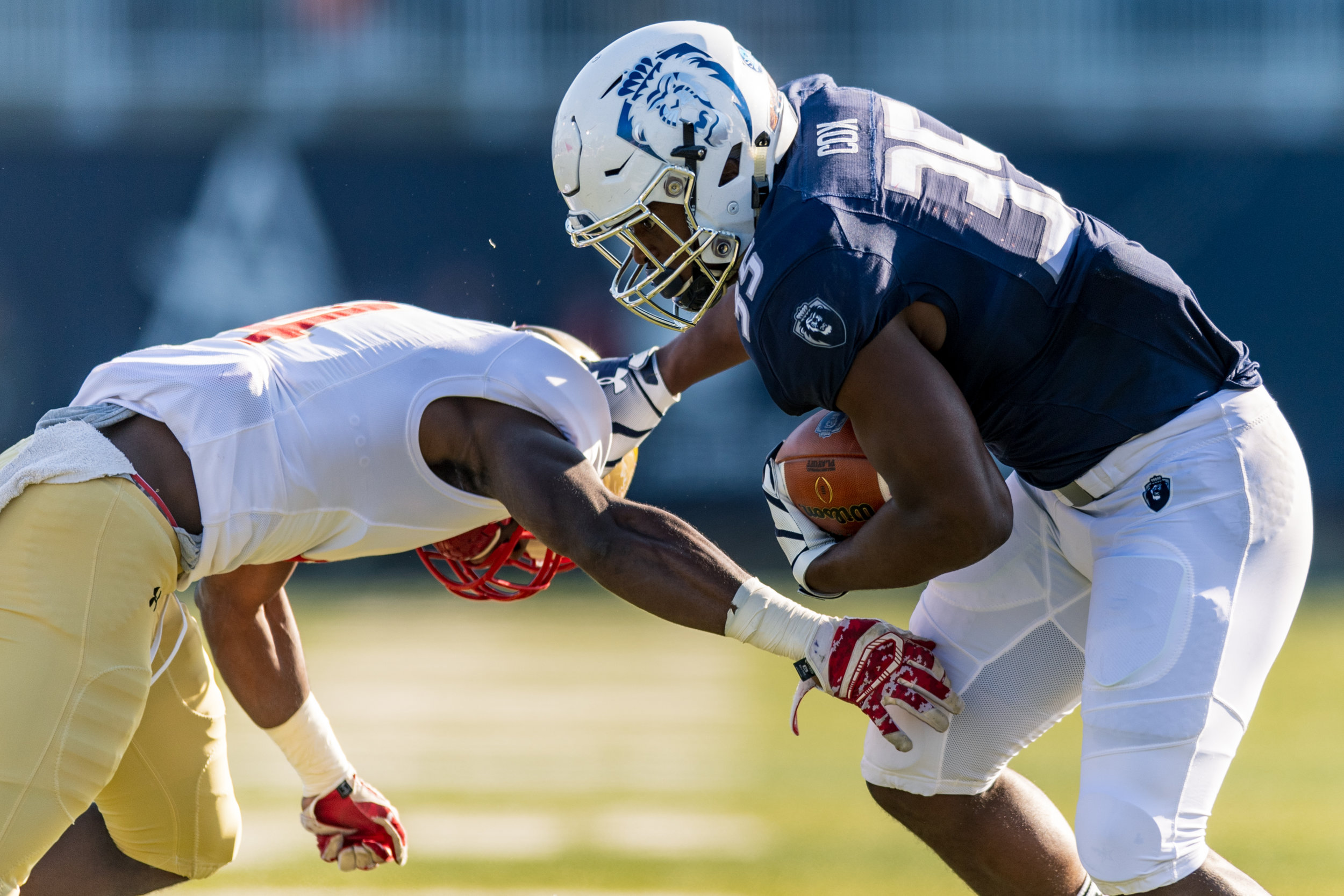 Old Dominion Monarchs running back Jeremy Cox (35) slips by Virginia Military Institute Keydets defensive back Uzoma Kpaduwa (4) during the Saturday, Nov. 17, 2018 game held at Old Dominion University in Norfolk, Virginia. Old Dominion leads VMI 49 to 0 at halftime.