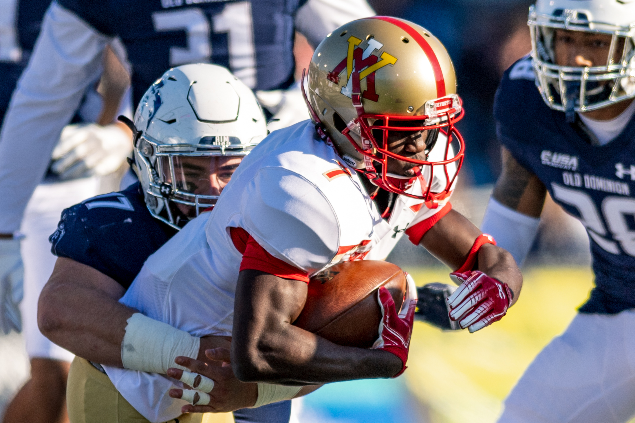 Virginia Military Institute Keydets wide receiver Javeon Lara (7) gets tackled by Old Dominion Monarchs defensive tackle Pat Toal Jr. (17) during the Saturday, Nov. 17, 2018 game held at Old Dominion University in Norfolk, Virginia. Old Dominion leads VMI 49 to 0 at halftime.