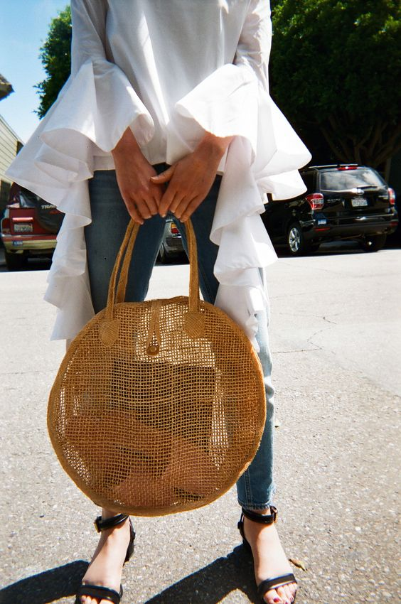 4. Minimalistic straw bag: I am obsessed with sleek, sophisticated (sometimes with a pop of color) bags. For this season, I am loving them in straw! I think it is such a feminine touch that elevates every look!    Shop this gorgeous one  here !