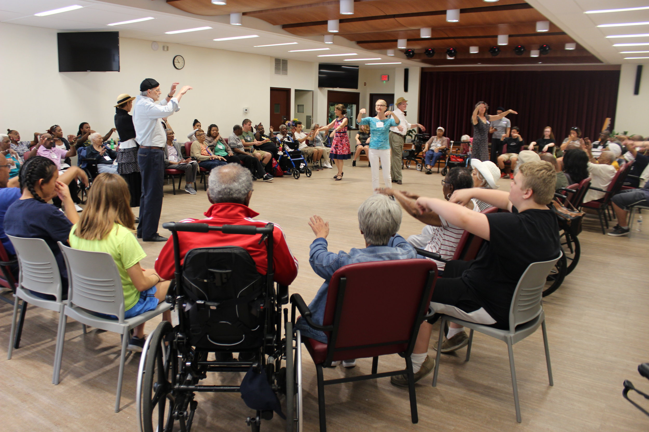 AFTA Teaching Artist Deborah Riley, with René Dávila and Tango Mercurio dancers, leads a warmup for older adults and City Service Mission students (photo by Flora Le)