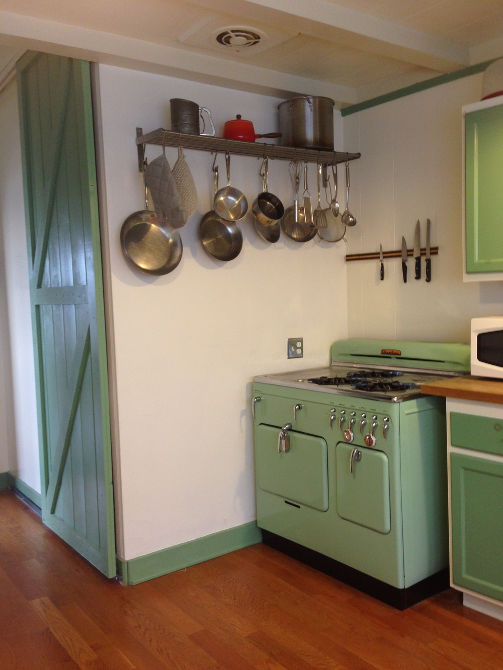 The kitchen had the original stove, and a cool sliding barn door, for the pantry. I loved the colors!