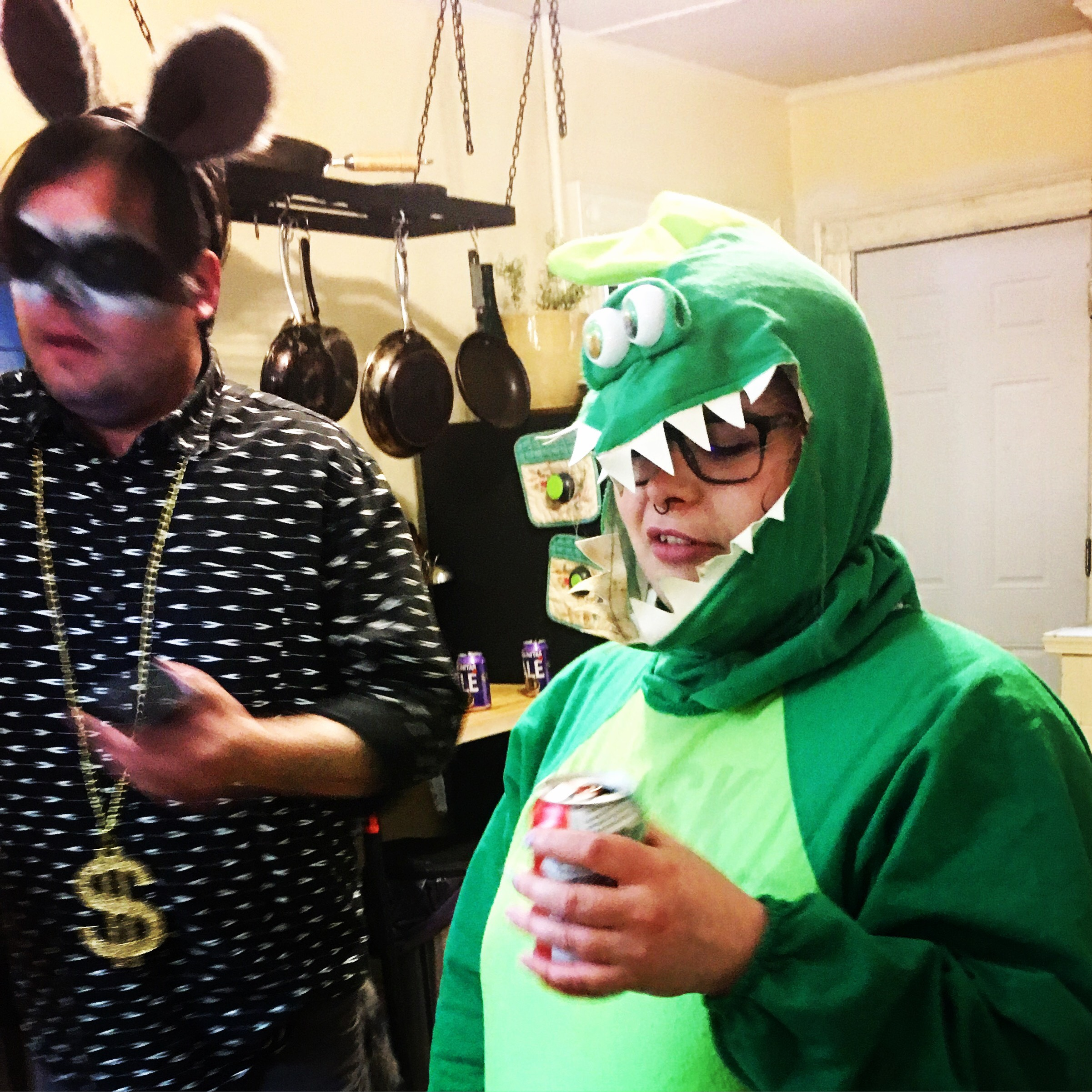 Will and Brittany dressed as their spirit animals (raccoon and Godzilla, respectively) at a video shoot we did.