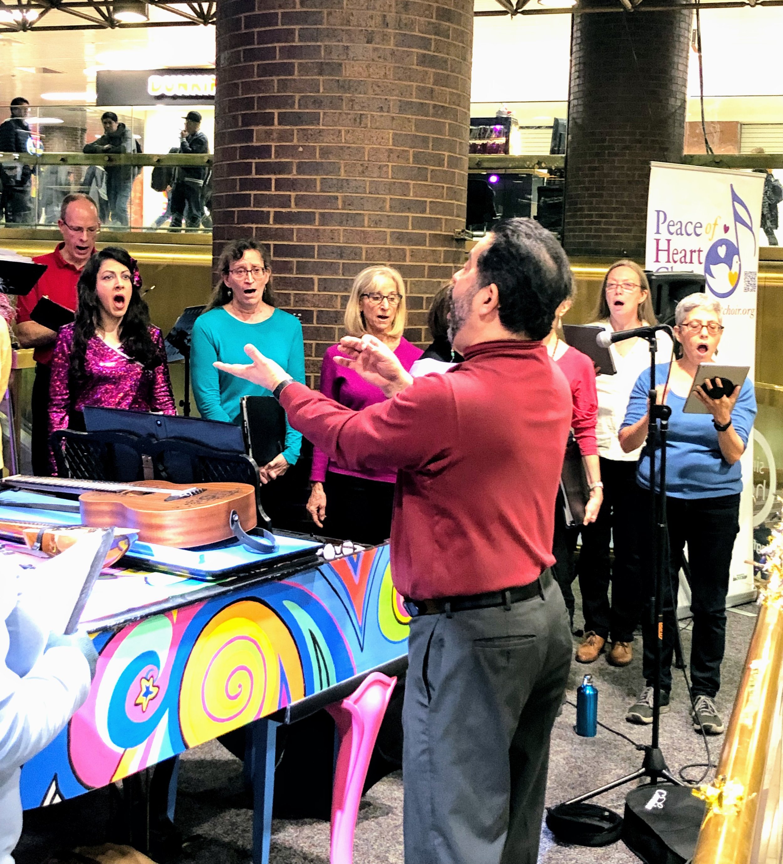 Maestro Renè Galvan conducts the choir at New York's Port Authority
