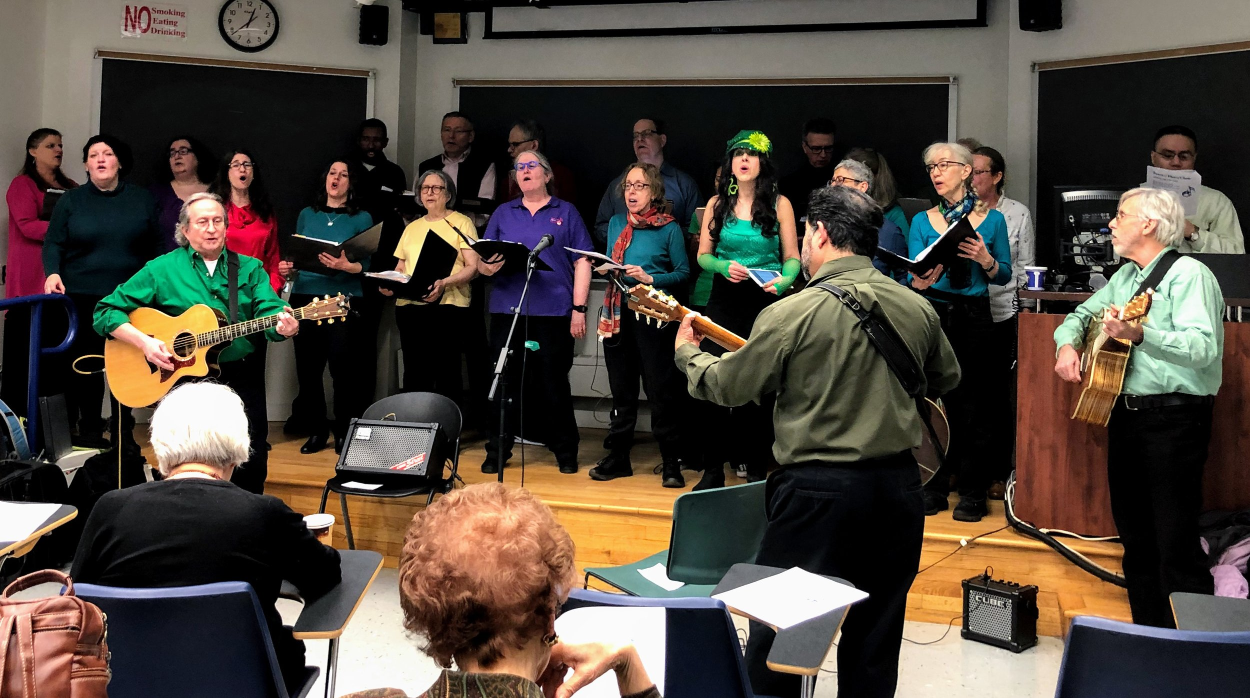 Three guitarists accompany the choir on the song,  Fragile ,   performed at  Sundays at JASA  .  JASA stands for the Jewish Association Serving the Aging .
