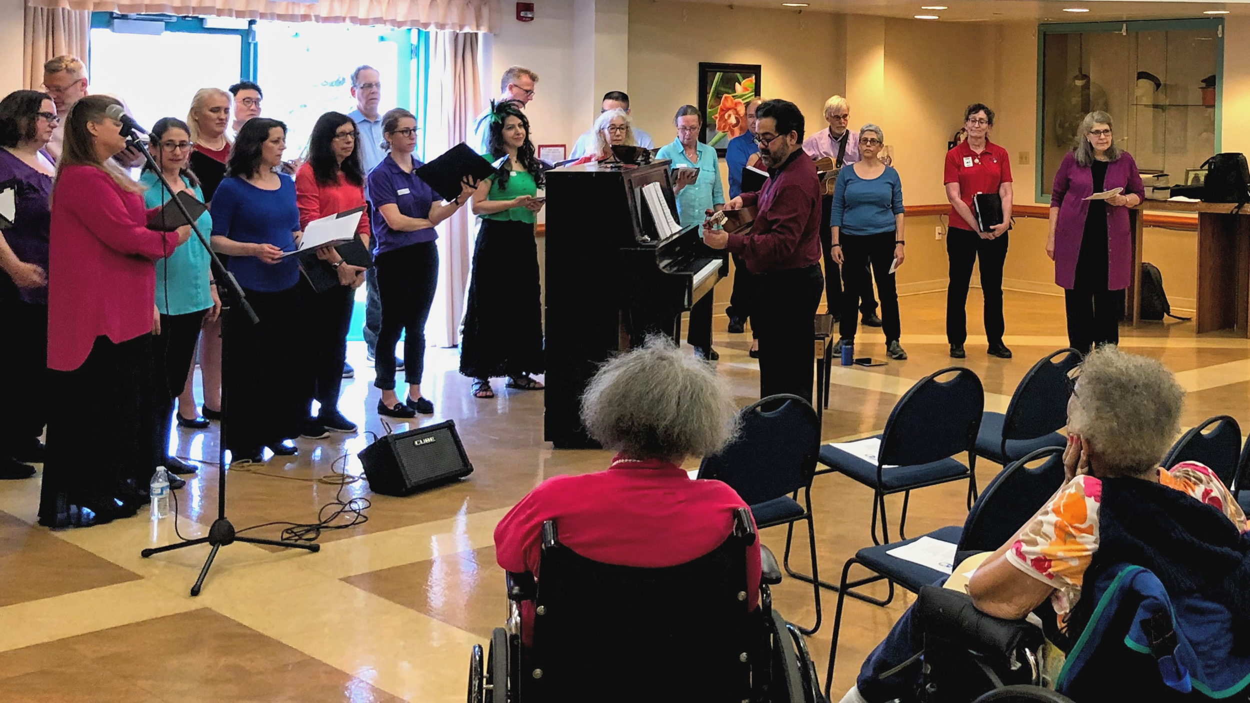The choir sang in the home's New York State Women Veterans Memorial Community Room