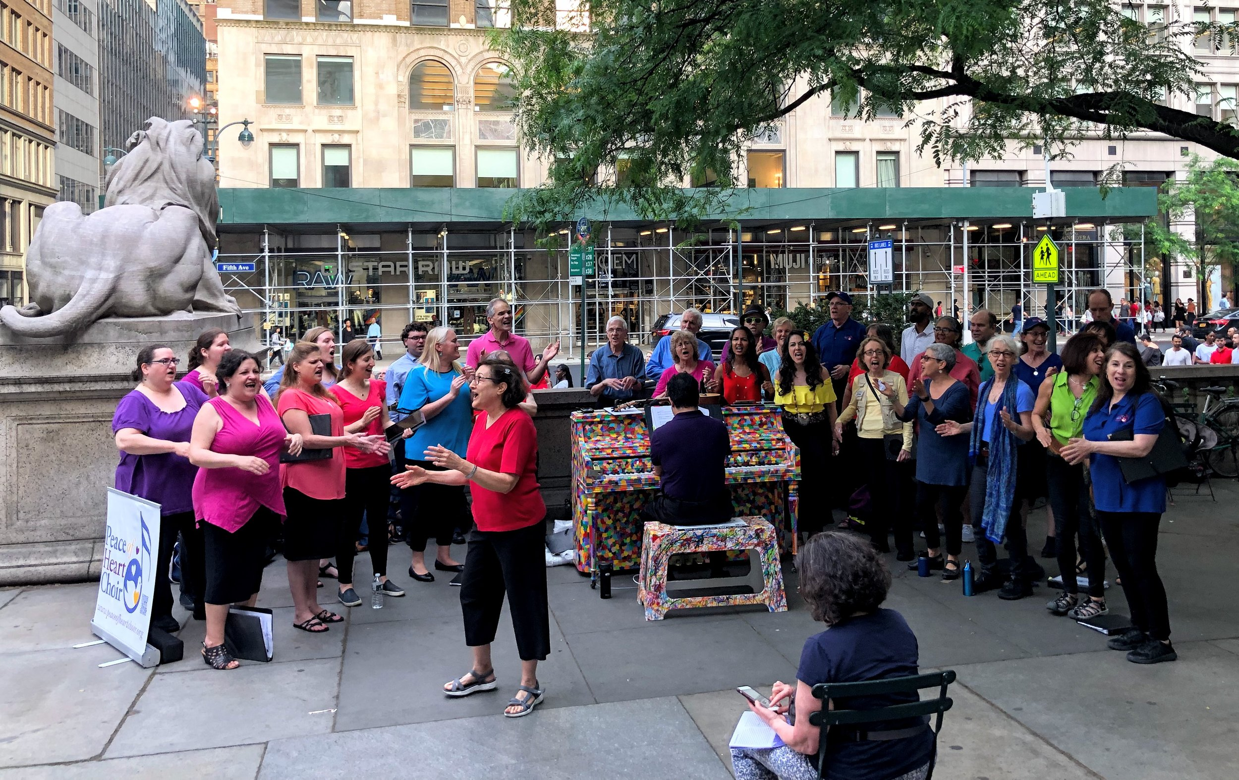 Choir member Nancy Gross leads the crowd in song near Bryant Park.