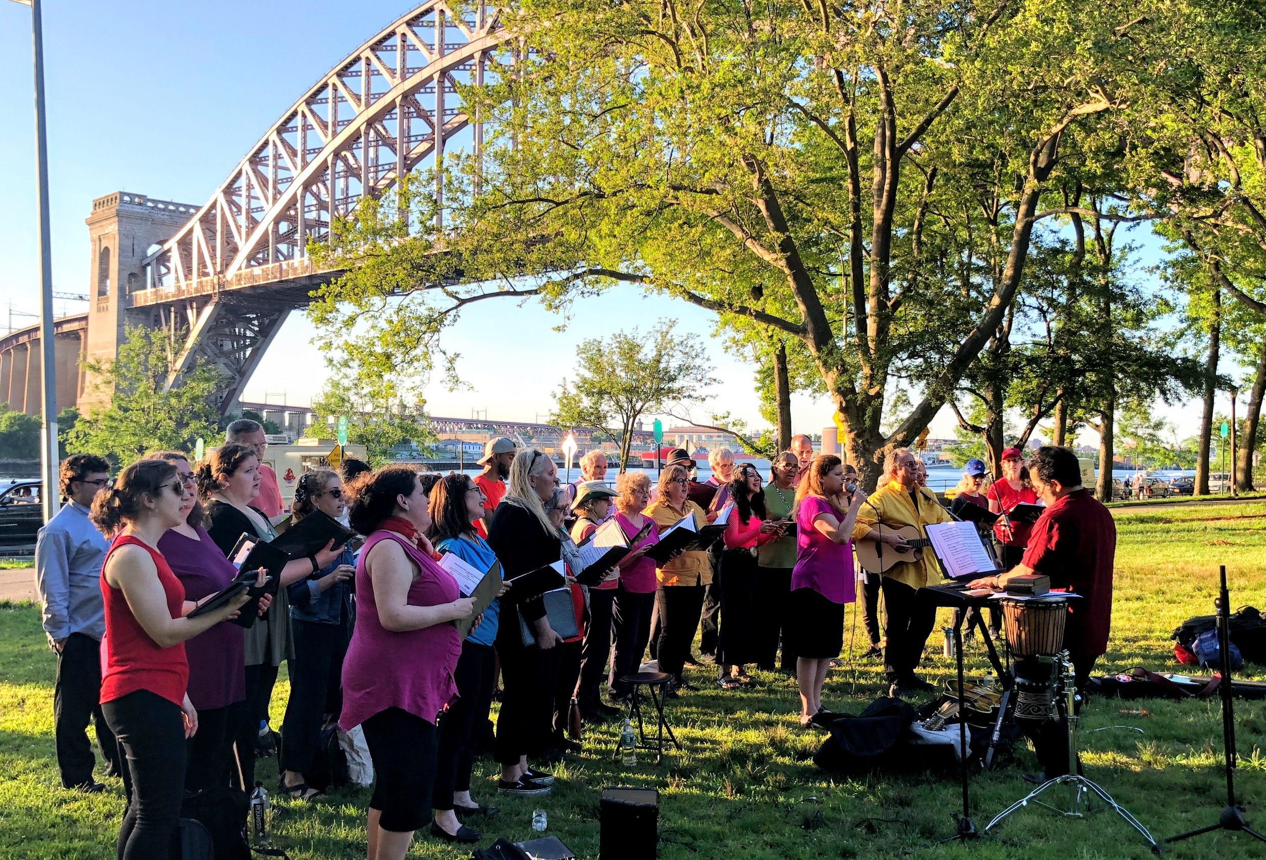 Singing near the East River beneath the Hell Gate Bridge in Astoria Park.