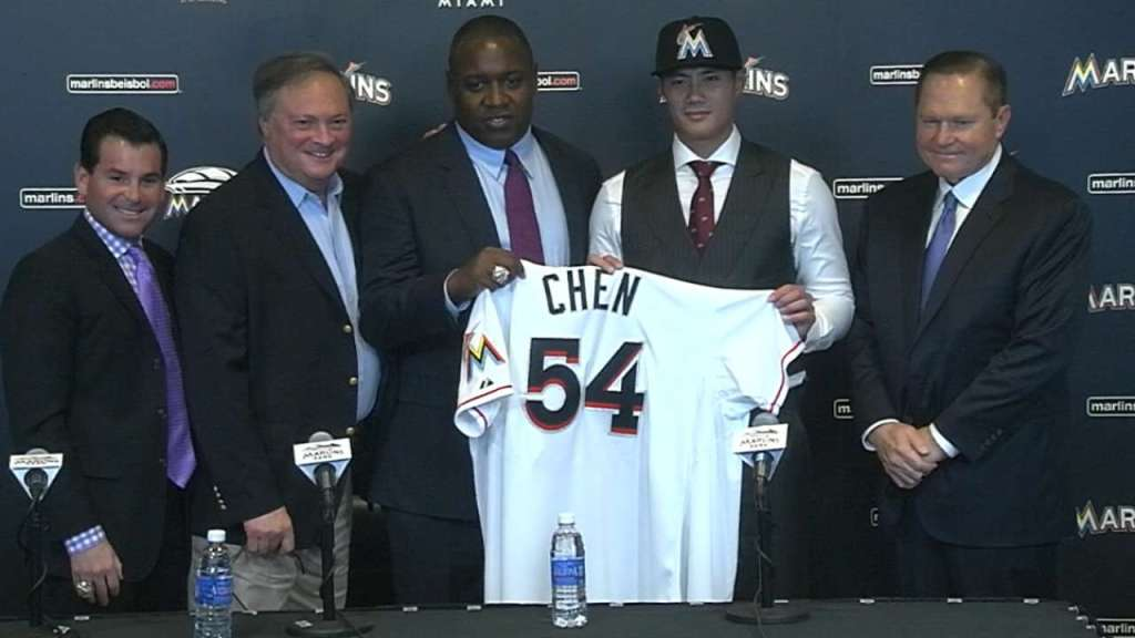 David Samson (left) pictured with Scott Boras (right) after Marlins signed Wei-Yin Chen (Credit: mlb.com)